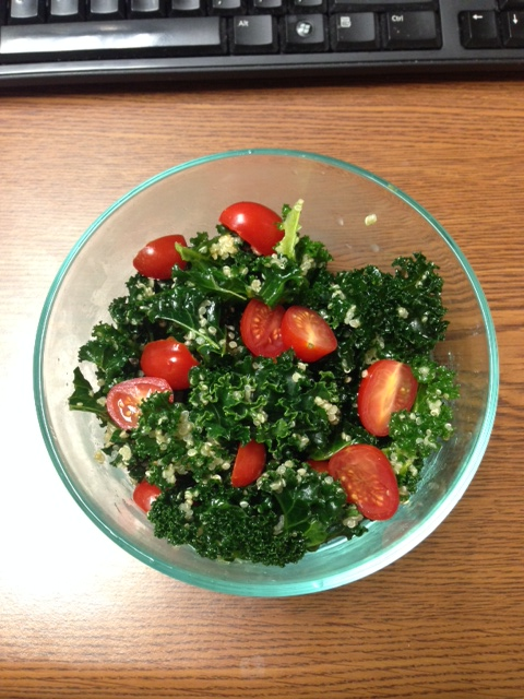 Kale-quinoa salad with cherry tomatoes, tossed in homemade olive oil-garlic-lemon dressing