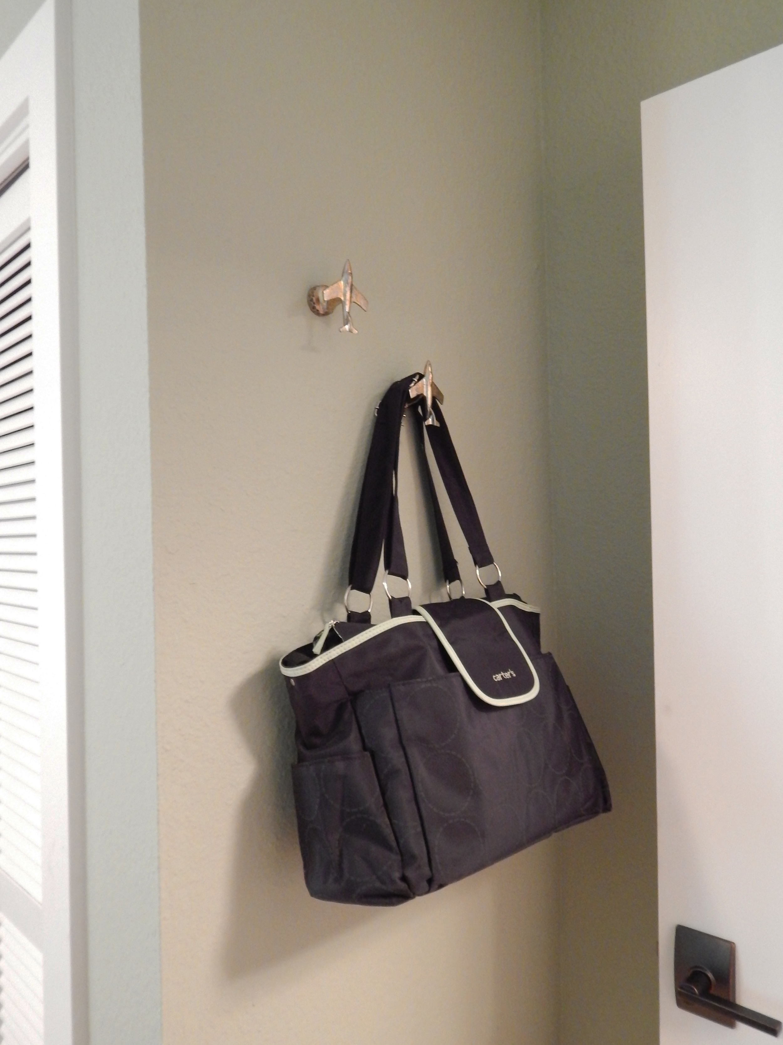 Airplane hooks by the entry door