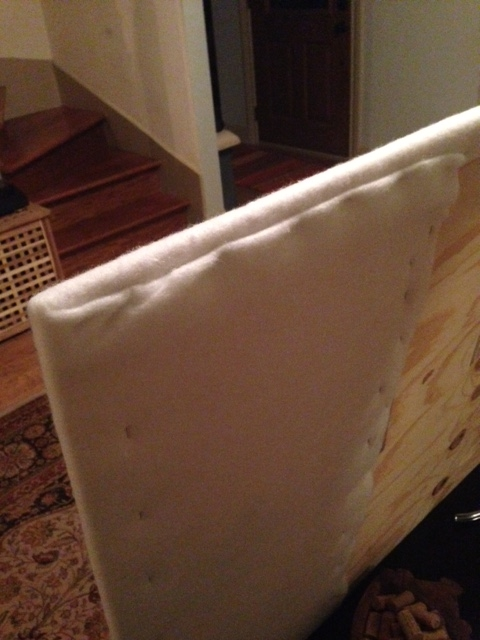 Step Three: Staple batting to plywood with staple gun. Fold and staple corners as if you're wrapping a giant gift.