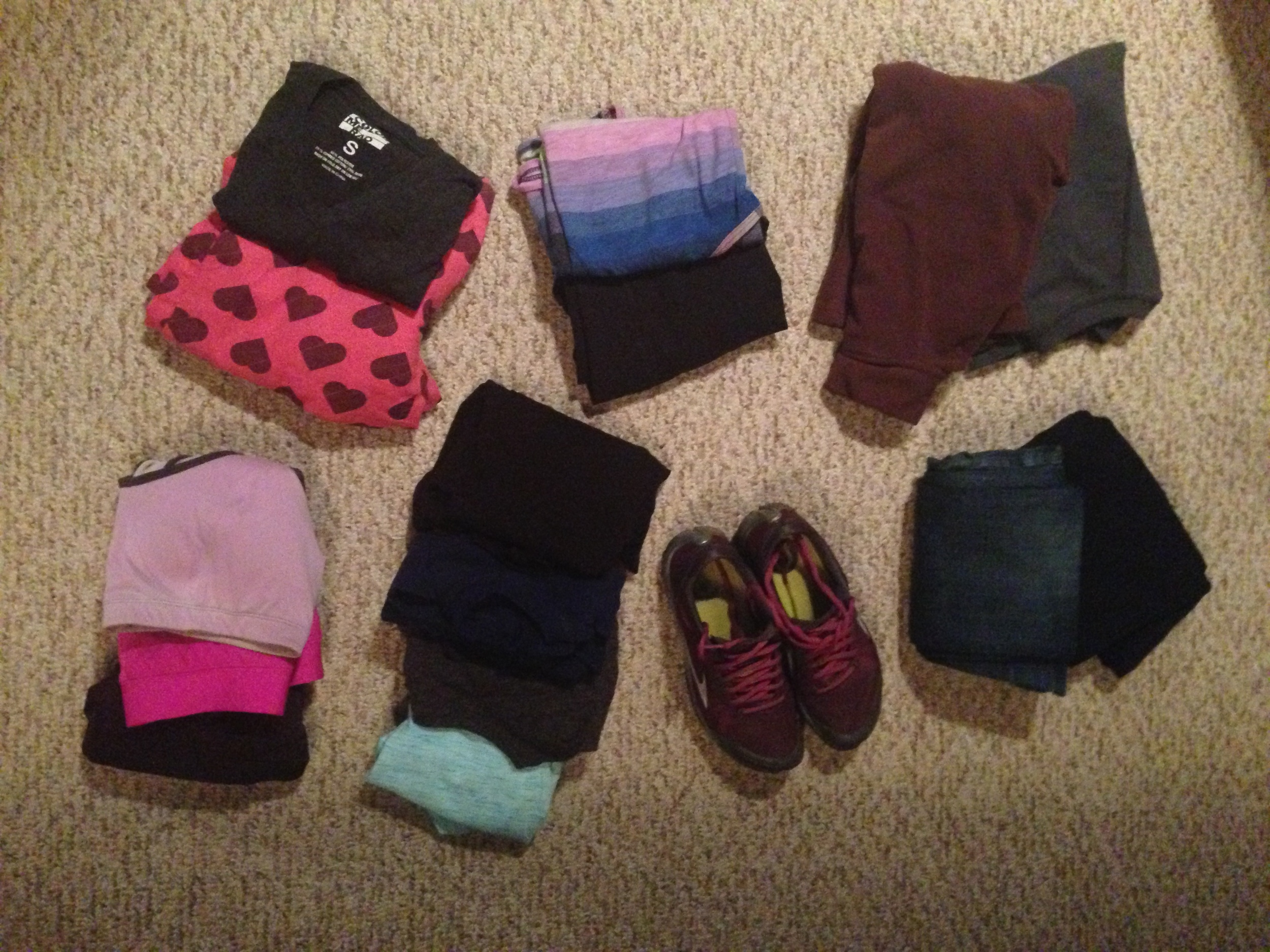 Left to right, top to bottom: PJ pants and two pairs of tee shirts, workout outfit, two sweaters (wound up only packing one and a not-pictured jacket), sports bras, five shirts (one long-sleeve, one 3/4 sleeve, three short-sleeved), walking shoes, two pairs of jeans (one medium-wash, one dark wash).