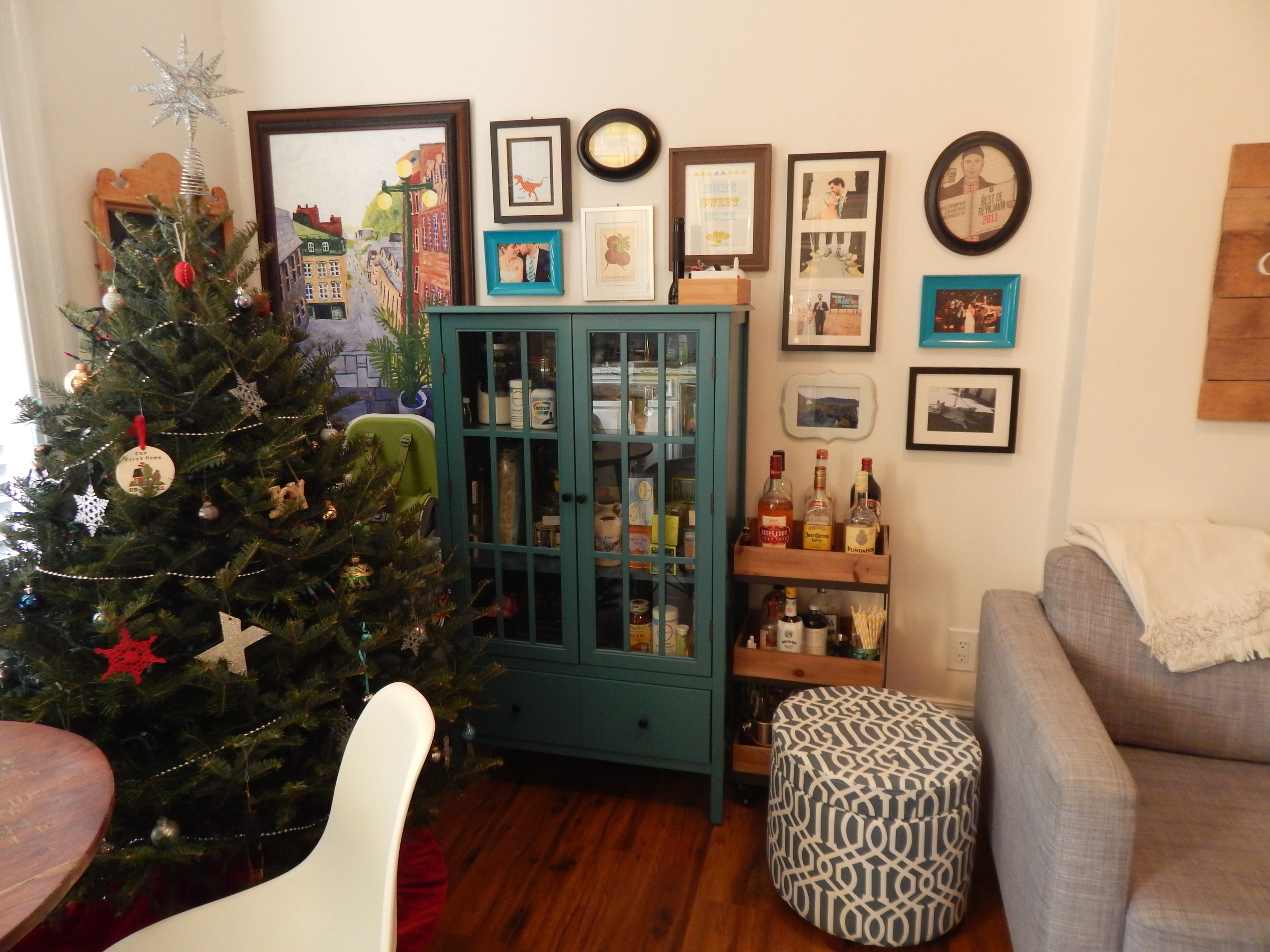View of our wall decor and dining area (currently where tree is) from the kitchen.