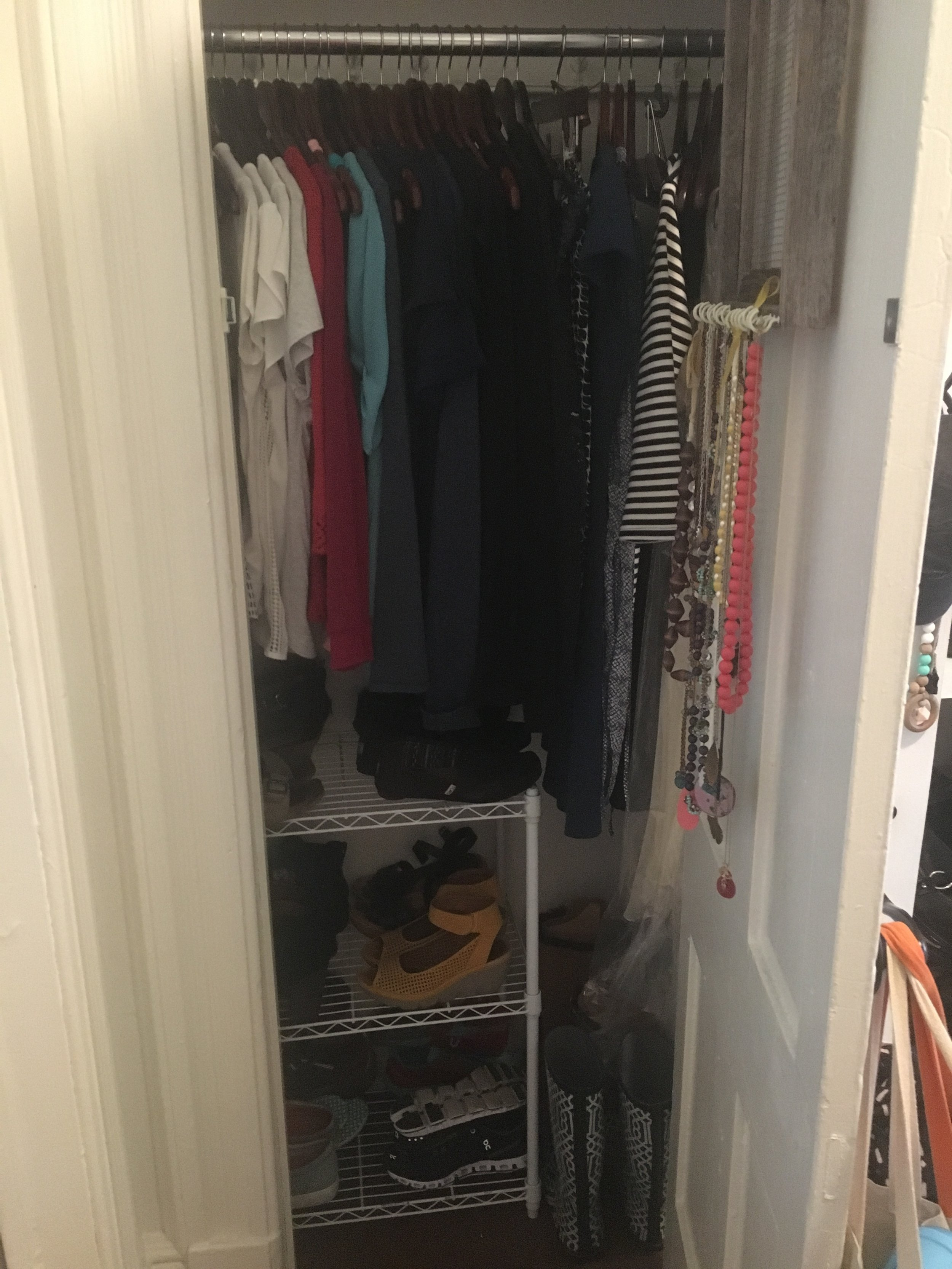 My closet in all its glory. See those bright necklaces? That's where the splash of color comes in!