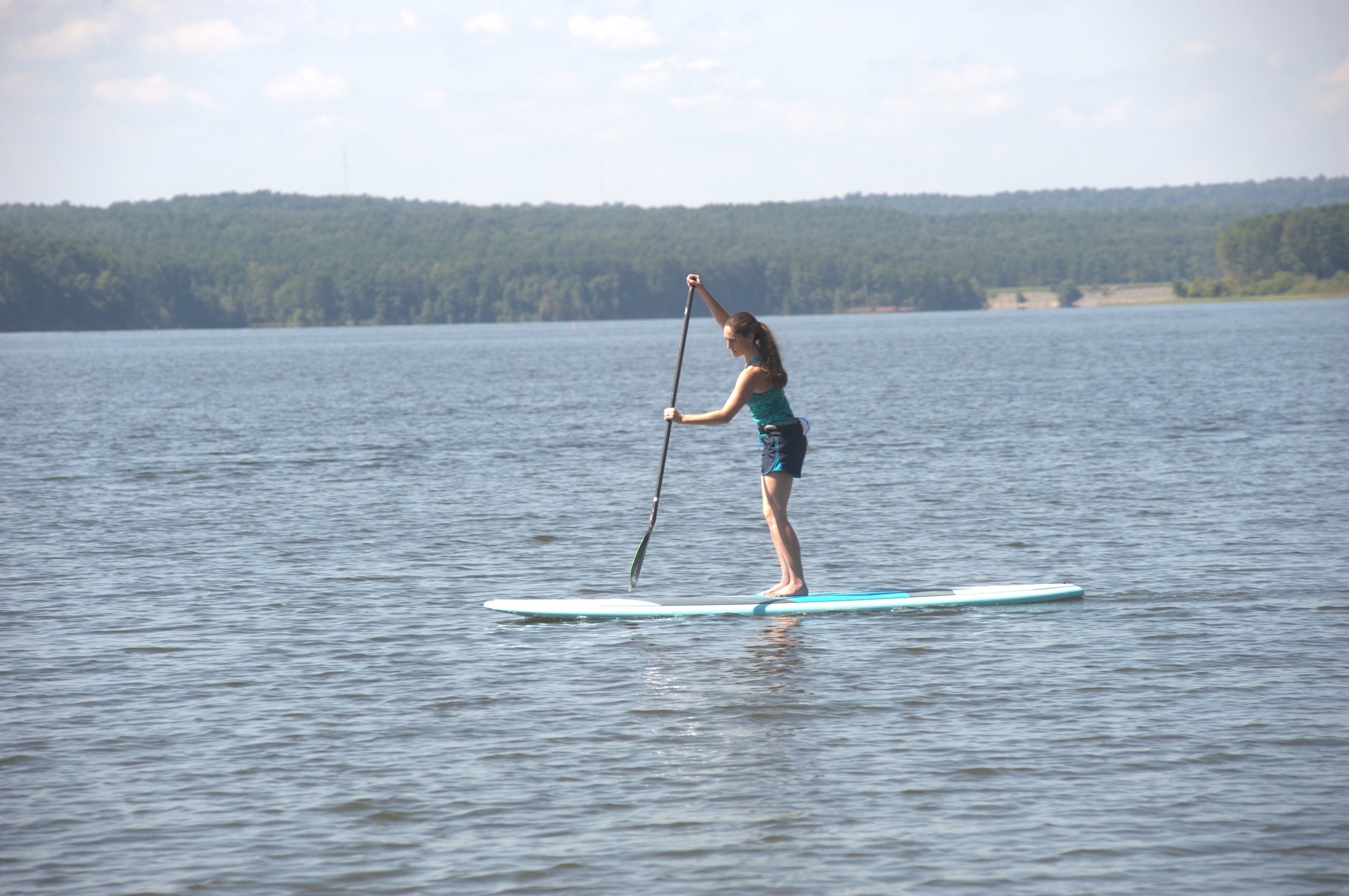Always hold the paddle so the blade is angled away from you (toward the nose of the board).
