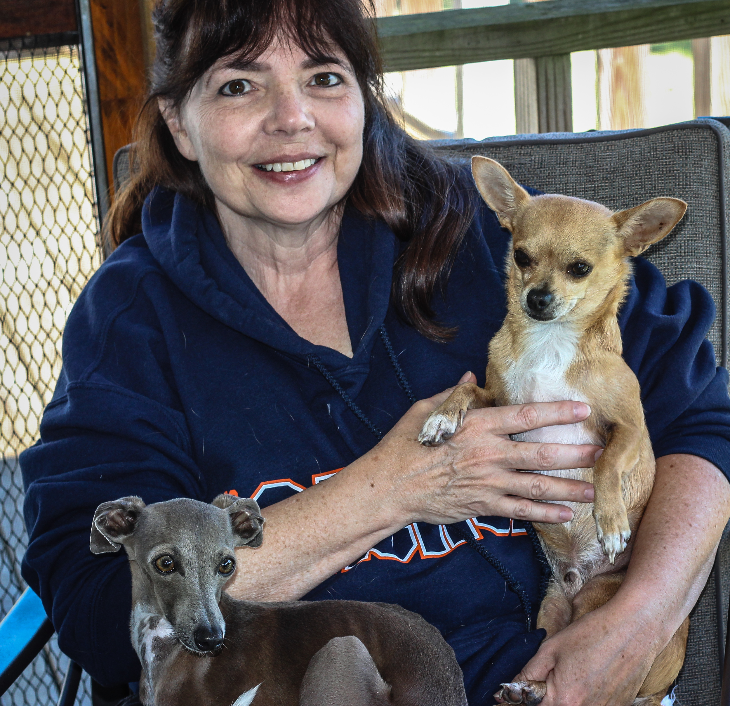 Mardie Sachse with her Canine Community Reporters; Chester & Pnut