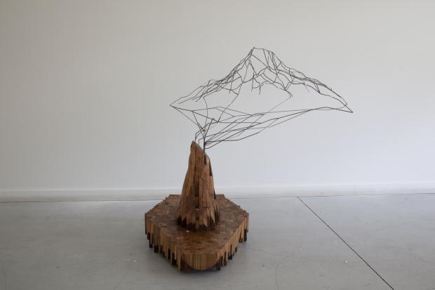 Greg Pond, Stump Errupts a Mountain  2011, wood steel
