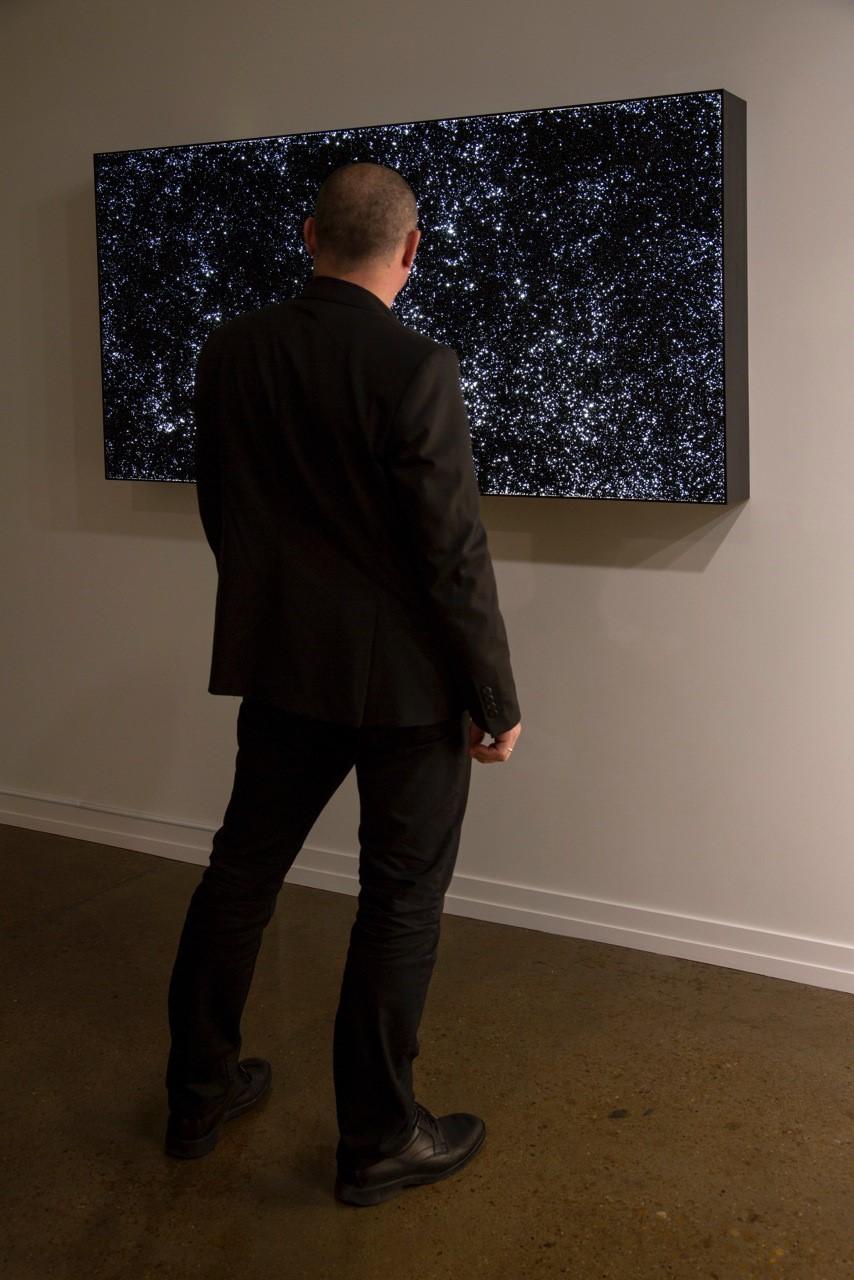 """Installation of My God, It's Full of Stars, vinyl pellets on lightbox, 36""""x66"""", 2014"""