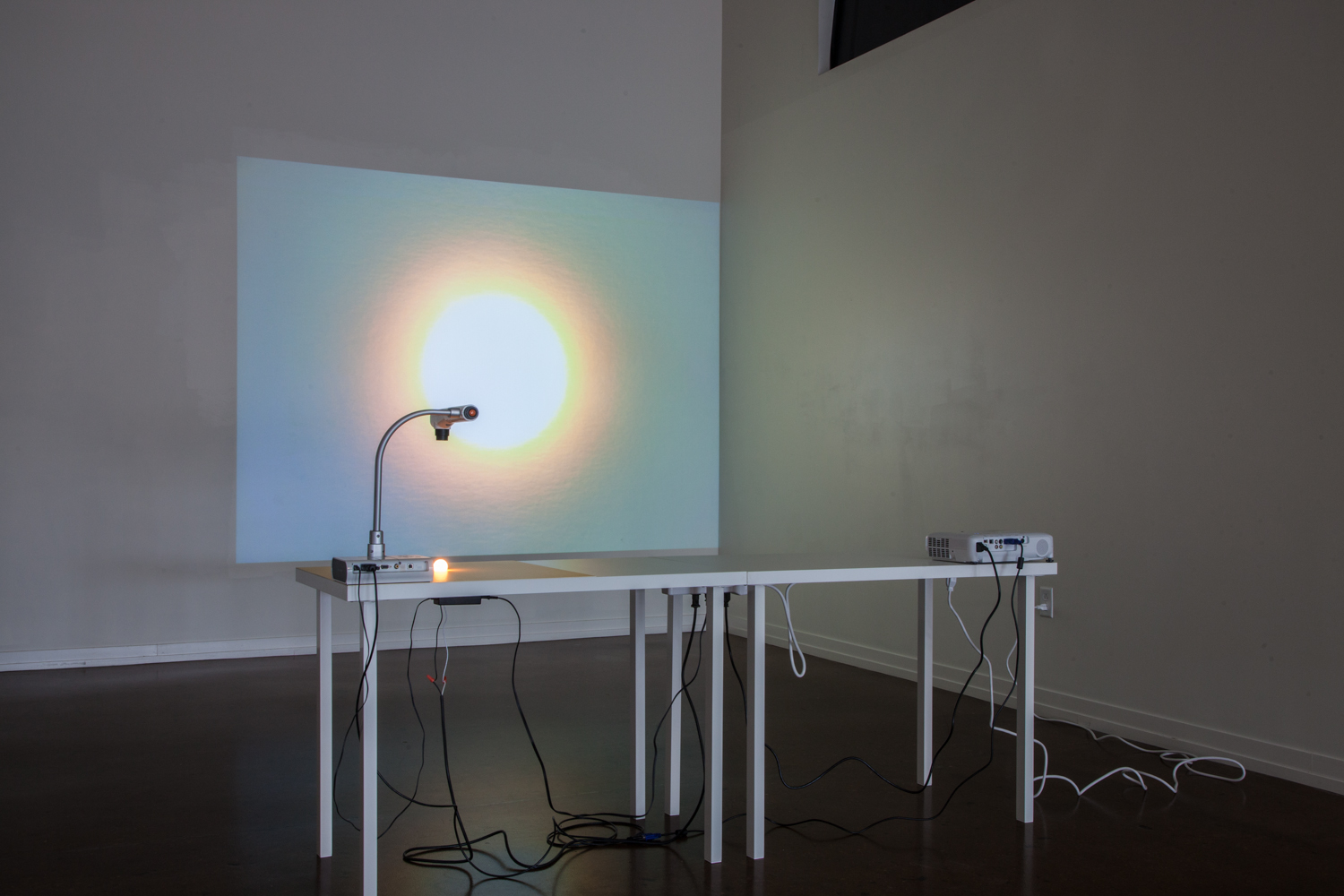 Patrick DeGuira- Building a Sun, 2015 - 16 Digitizer, video projector, 7W bulb, matboard, prefabricated table tops, painted steel; dimensions variable