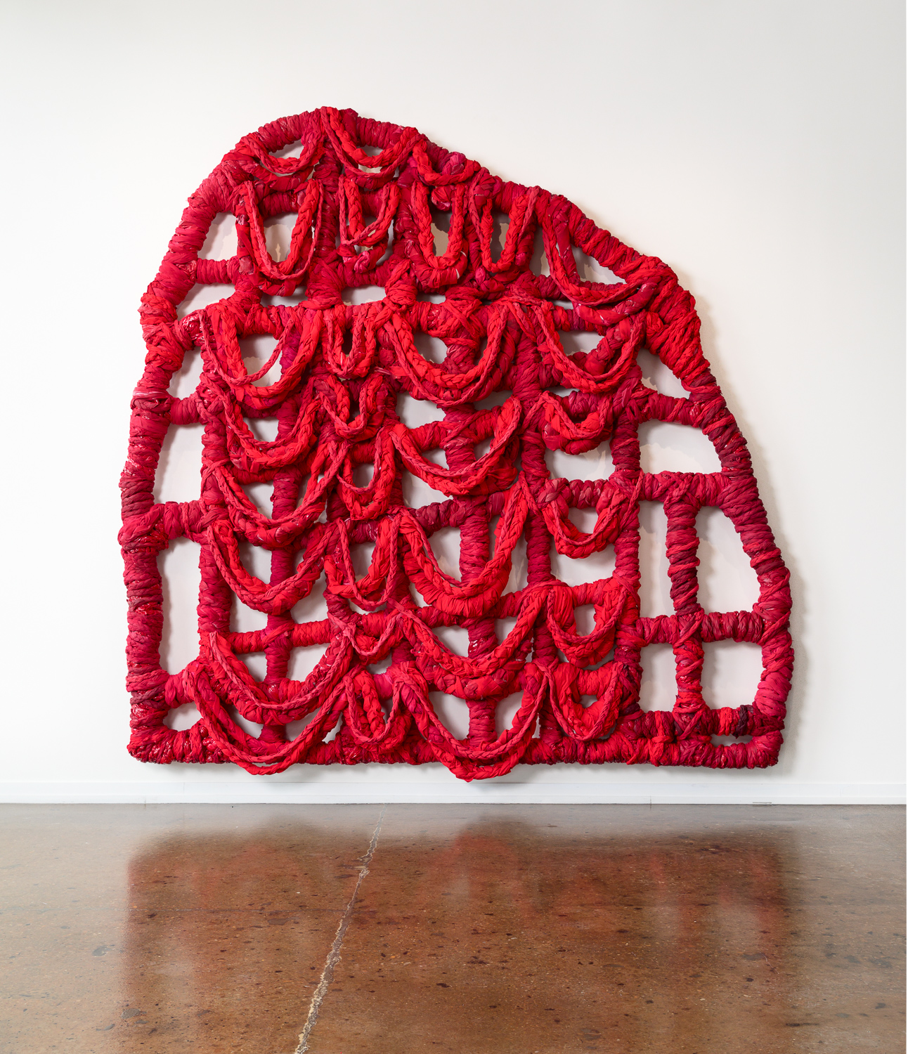 Red Gate, 118 x 120 x 10 inches, braided bedsheets, fabric dye, acrylic paint, acrylic resin, thread and wood, 2018