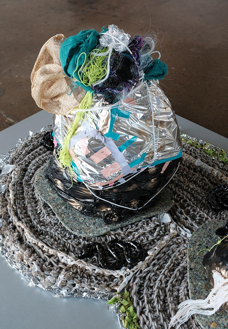 """Zipporah Thompson, solstice serpent, 2019, wire, paper, plastic, mylar, tape, handwoven cloth, thread, paper, burlap, foil, jute, paint, fabric 54""""L x 34""""W x 25""""H"""