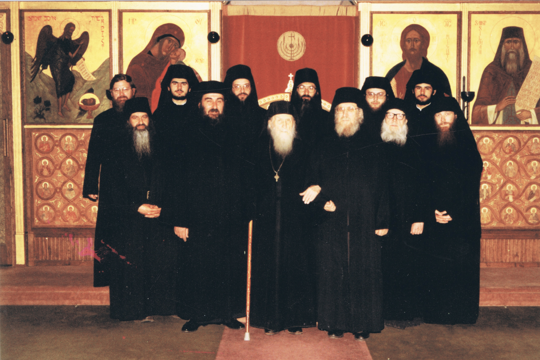Members of the monastic community Patriarchal Stavropegic Monastery of St. John the Baptist, Essex, England. In the centre the beloved Elder Sophrony Sakharov, 1990. Courtesy: Michael Family Archives.