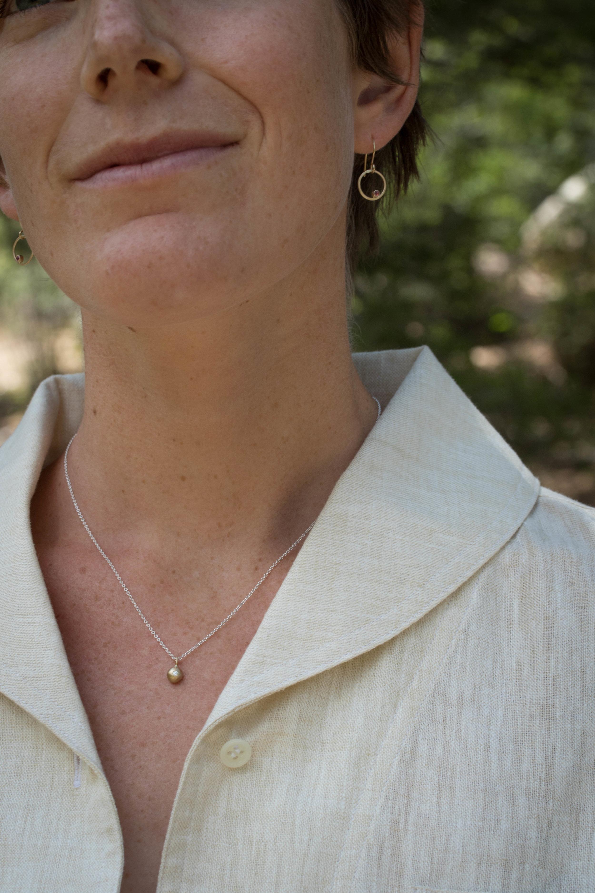 RMG Circe Ruby earrings and Diamond Orb necklace on Sonia.jpg