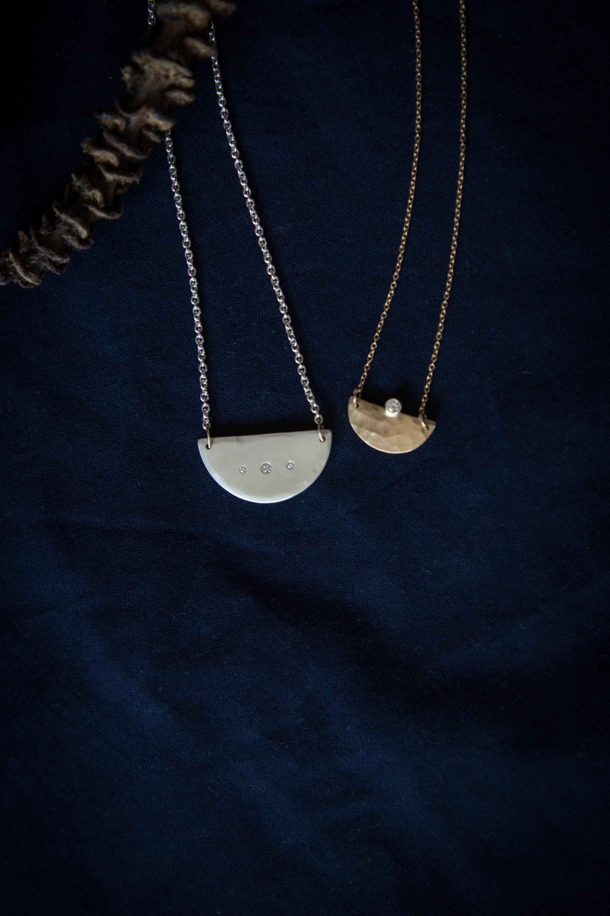 Silver and Gold Diamond Mavericks necklaces.jpg