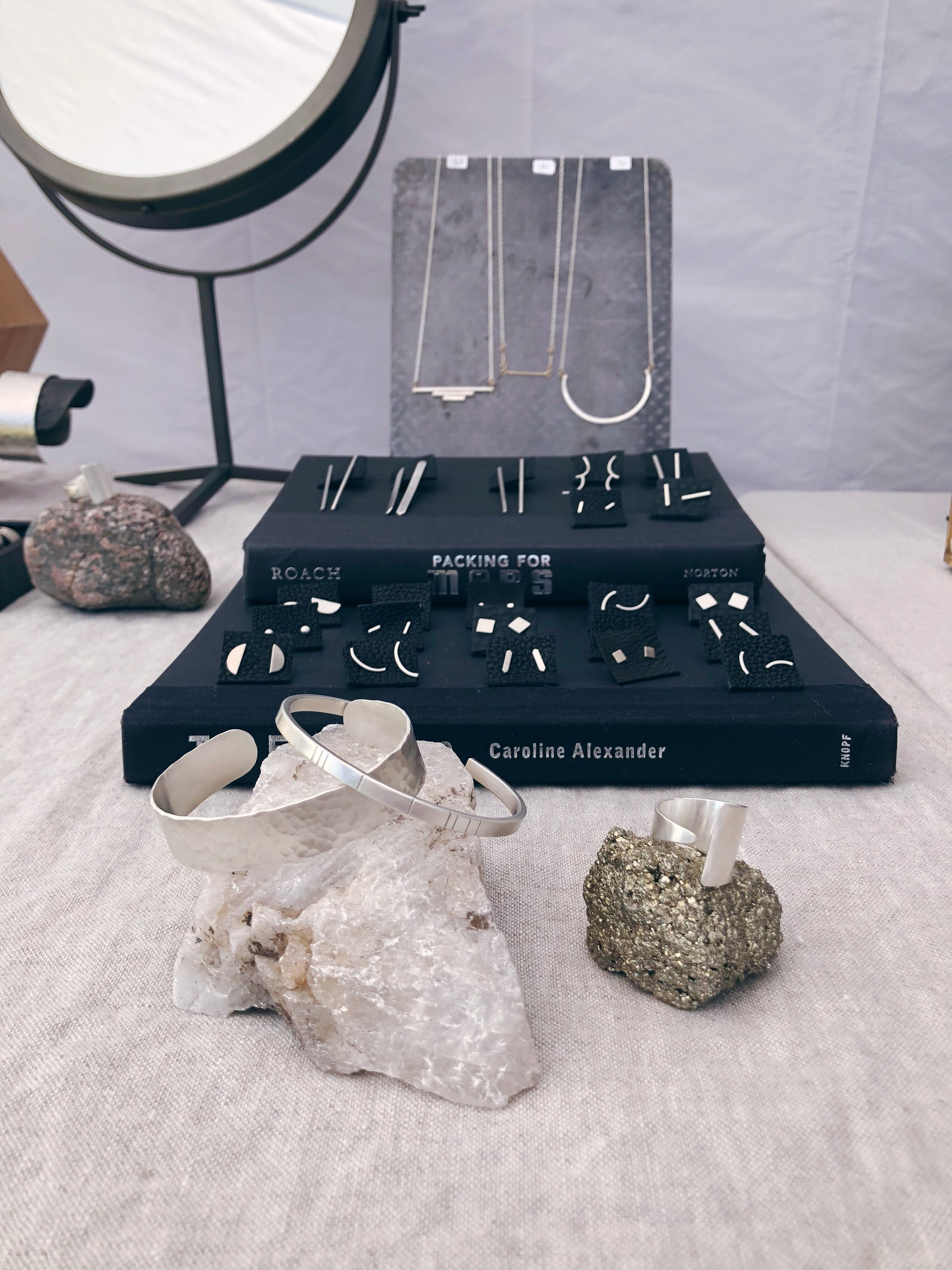sterling silver pieces on my favorite books and rocks! (the  Endurance  by Caroline Alexander and  Packing for Mars  by Mary Roach)