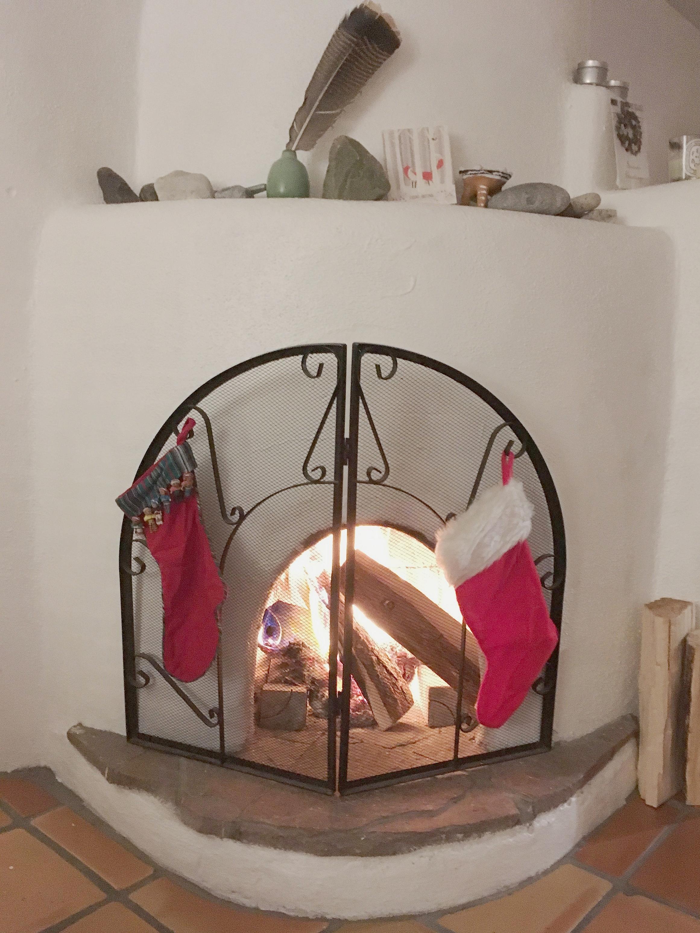 Santa Fe Christmas Style Kiva Fireplace - Rebecca Mir Grady