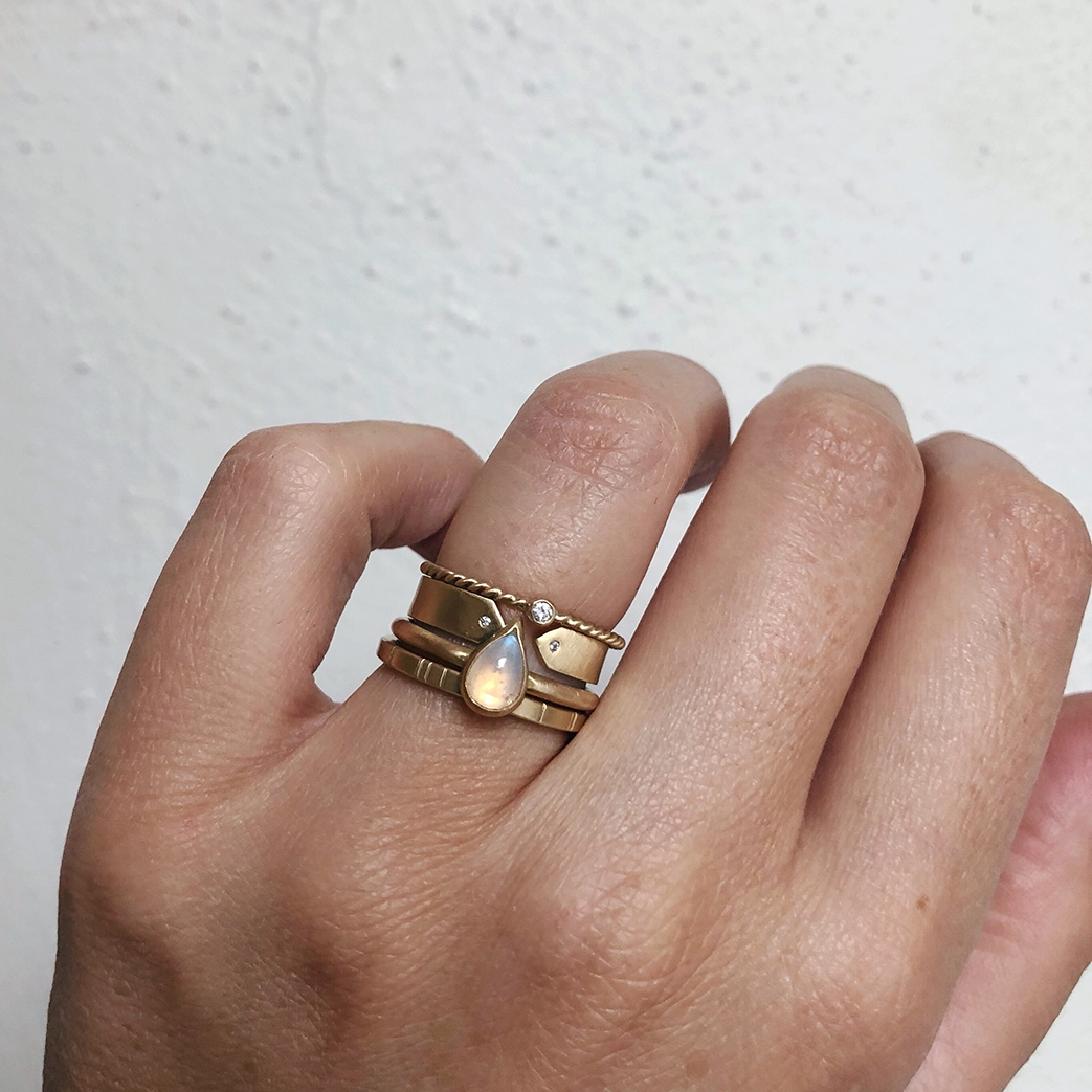 The custom teardrop moonstone ring with the  2mm Breakwater , Diamond McLeod, and  2mm Diamond Rope  rings in all 14k yellow gold.