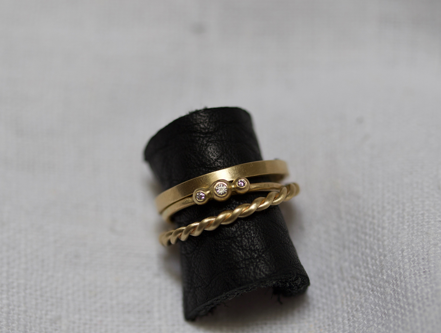 More texture mixing with the  Plain Rope  ring,  Petit Diamond Pré  and  2mm Highsmith  band in 14k yellow gold.