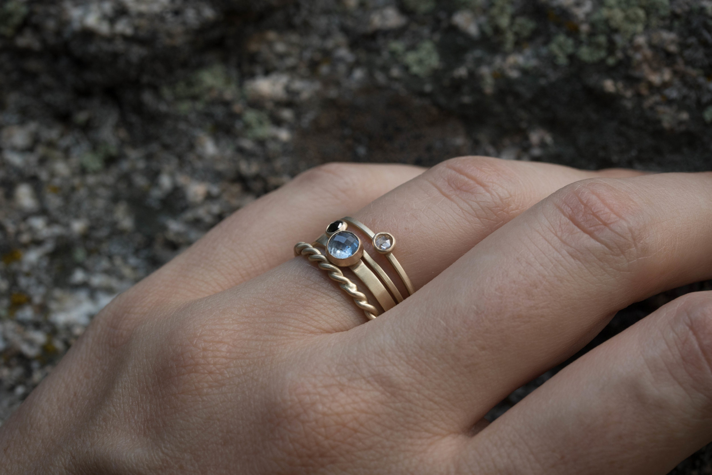 The  Plain Rope ,  Katherine Sapphire ,  Black Diamond Terence  and  White Diamond Terence  rings all in 14k yellow gold.