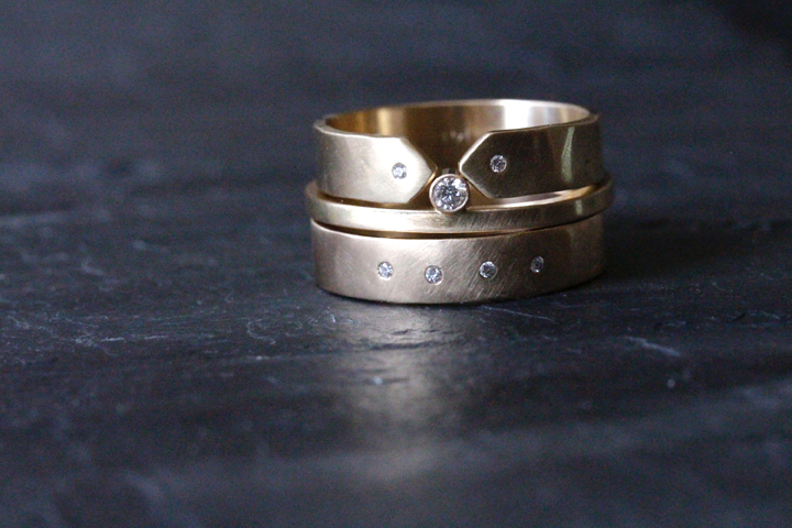 This edgy ring stack features the  4mm Diamond Highsmith  band, the Cape, and the Diamond McLeod ring in 14k yellow gold