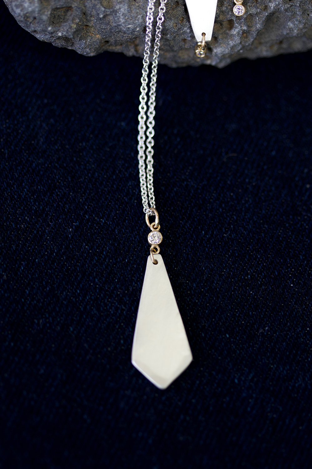 st margarets diamond drop necklace on denim.jpg