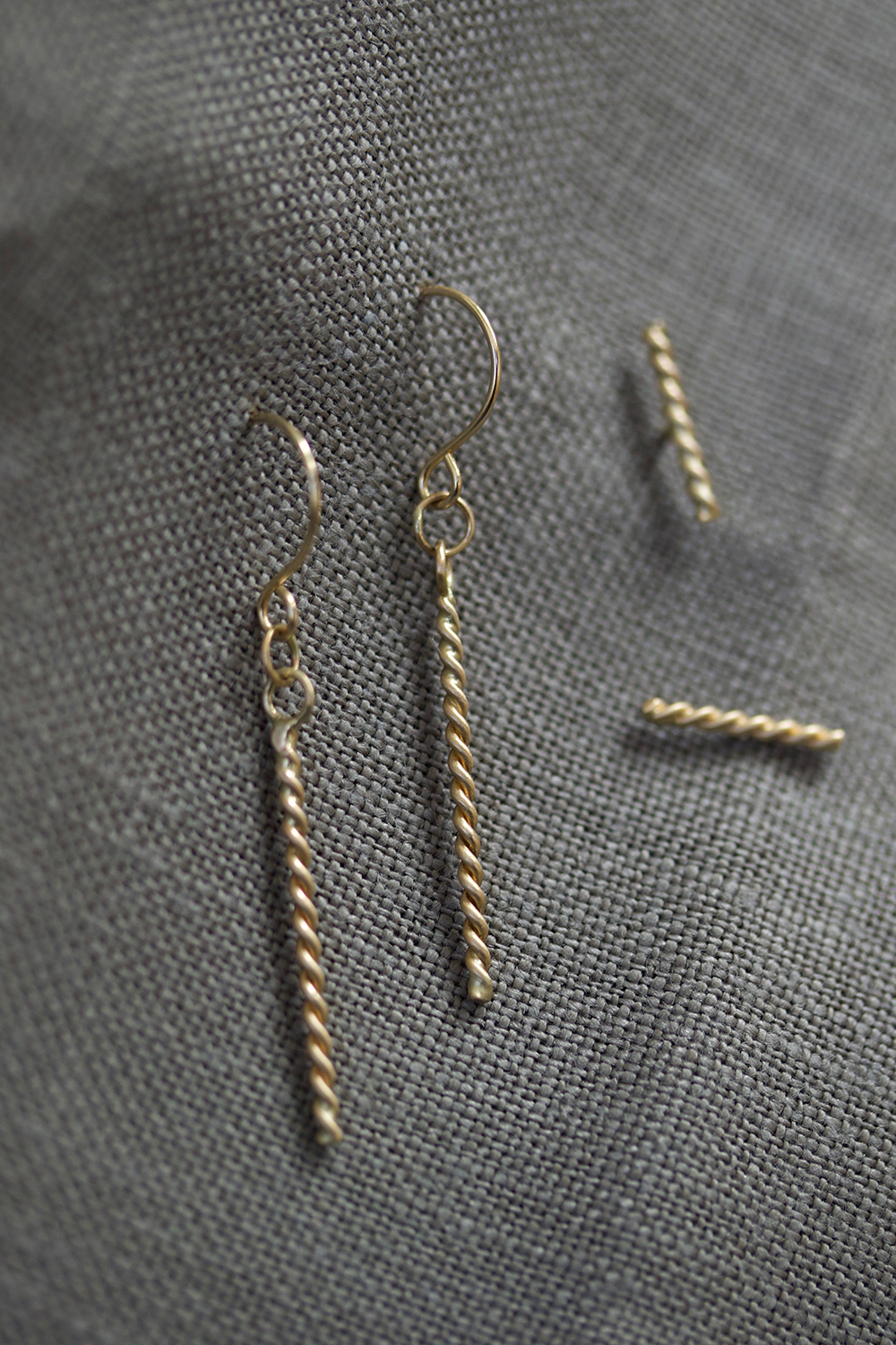 the  Rope Dash  and  Rope Drop Earrings , on a storm colored linen