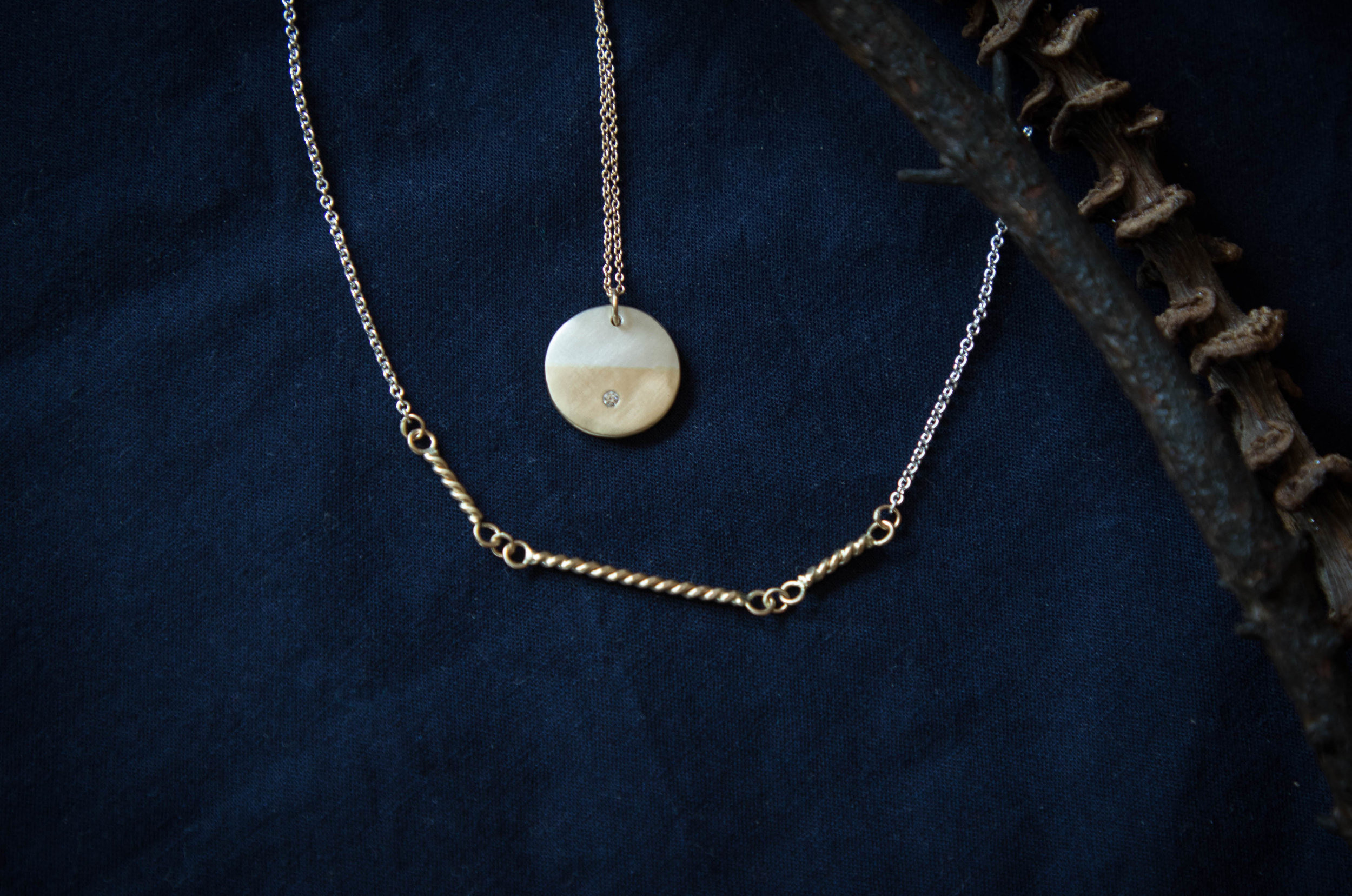 the  Sunrise Diamond  necklace in sterling silver and 14k yellow gold, along with the  Rope Jardín  necklace.