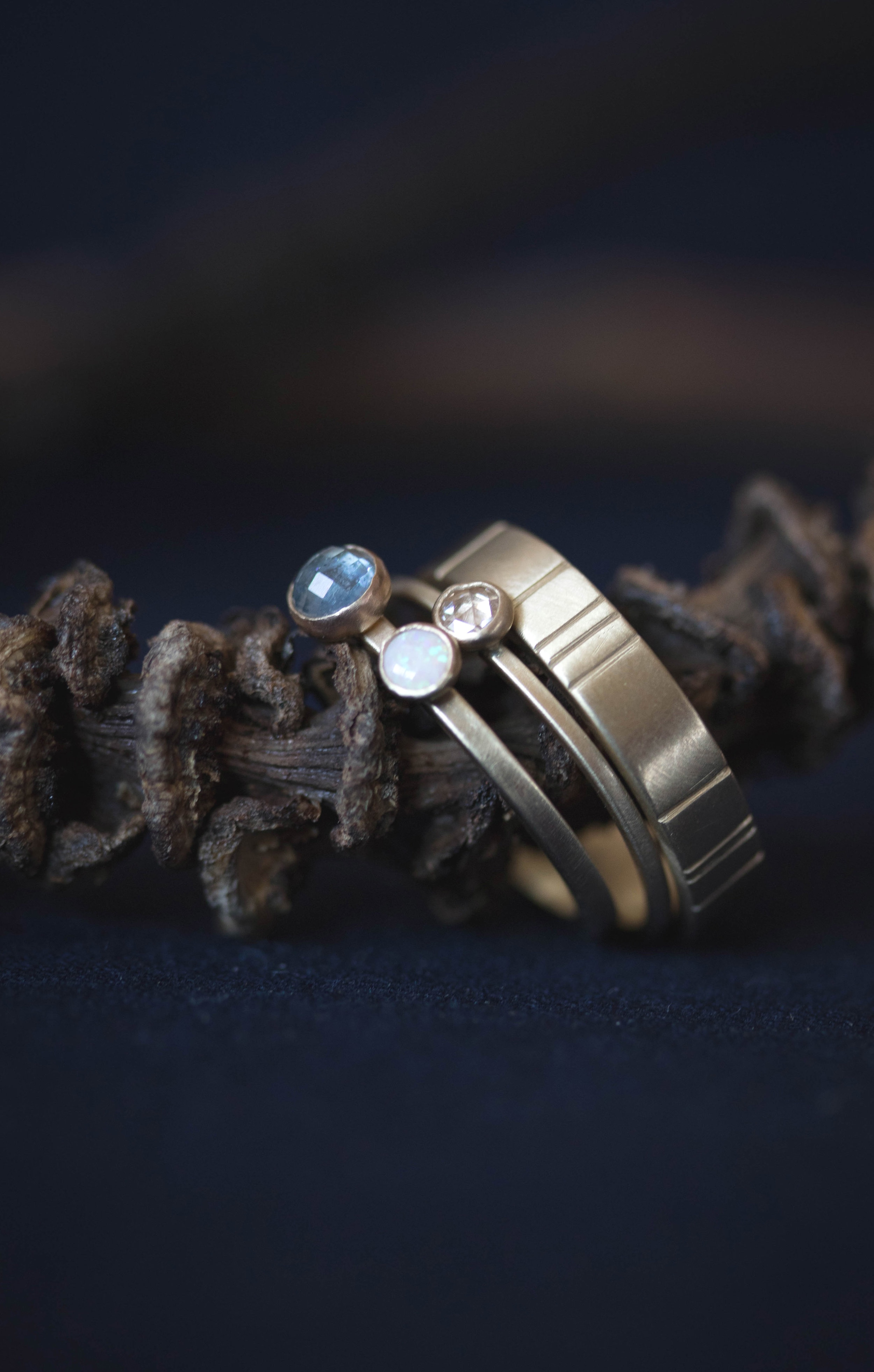 the  Georgia  ring with a rose cut sapphire and opal, along with the  rose cut diamond Terence  and a  4mm Breakwater  band, all in 14k yellow gold