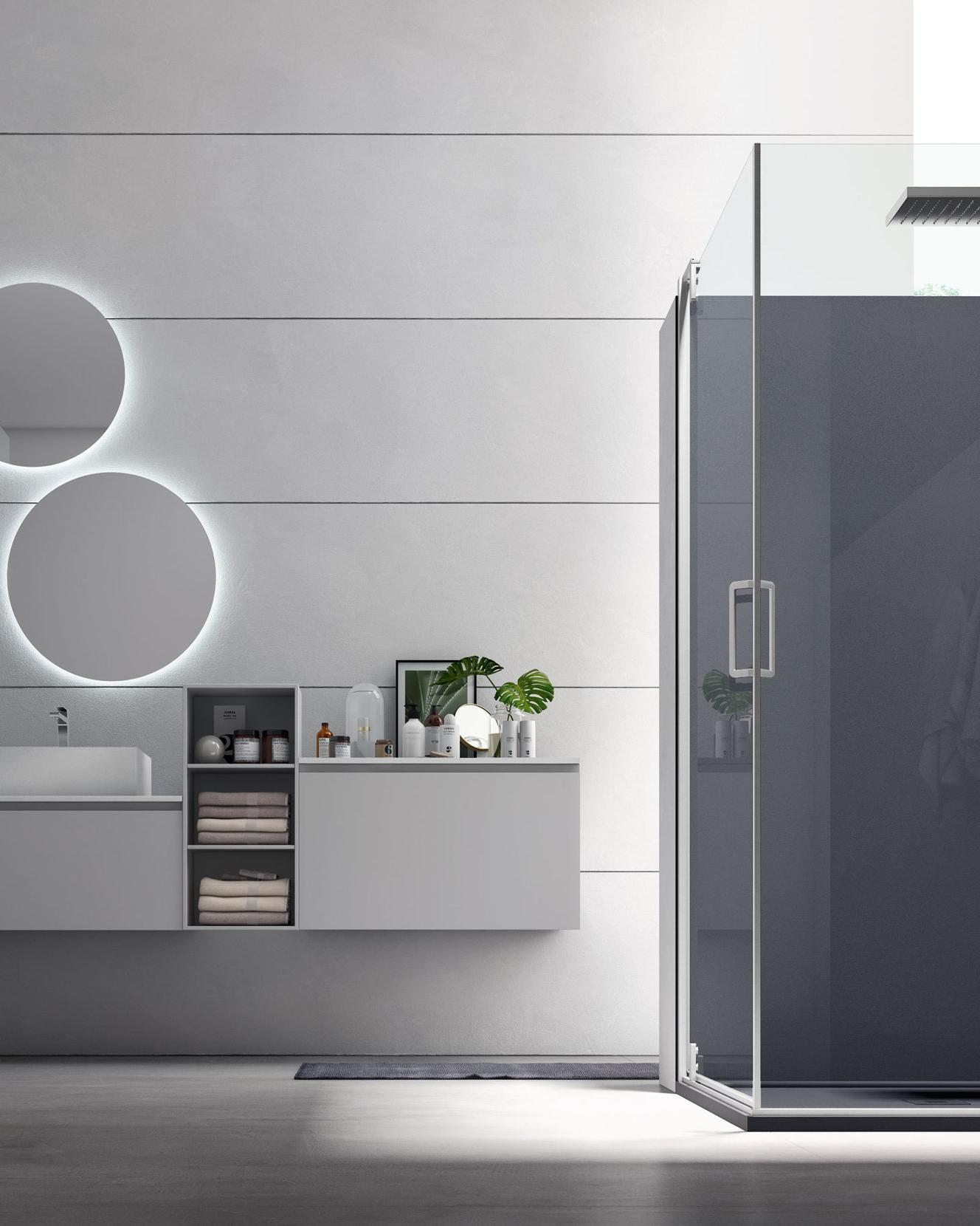 PANNELLI COORDINATI - I pannelli per rivestire le pareti sono la soluzione ideale per tamponare lo spazio di una vecchia vasca o come semplice scelta di stile, mantenendo la continuità delle superfici e creando un tutt'uno col piatto doccia.