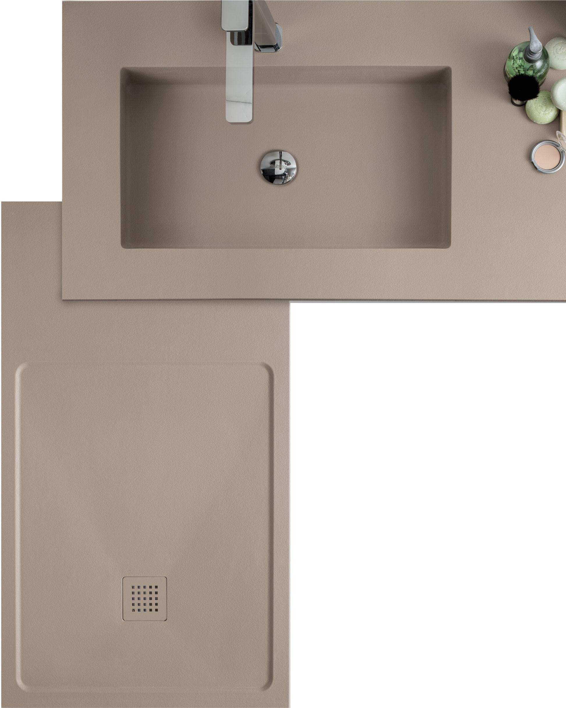 TOTAL LOOK - Lisce o materiche e in diverse tonalità, le finiture dei piatti doccia e dei pannelli per rivestire le pareti si abbinano ai top dell'arredobagno Arcom per creare un total look d'effetto. In Roccia, Pietra o Gres, personalizzano l'ambiente e il benessere.