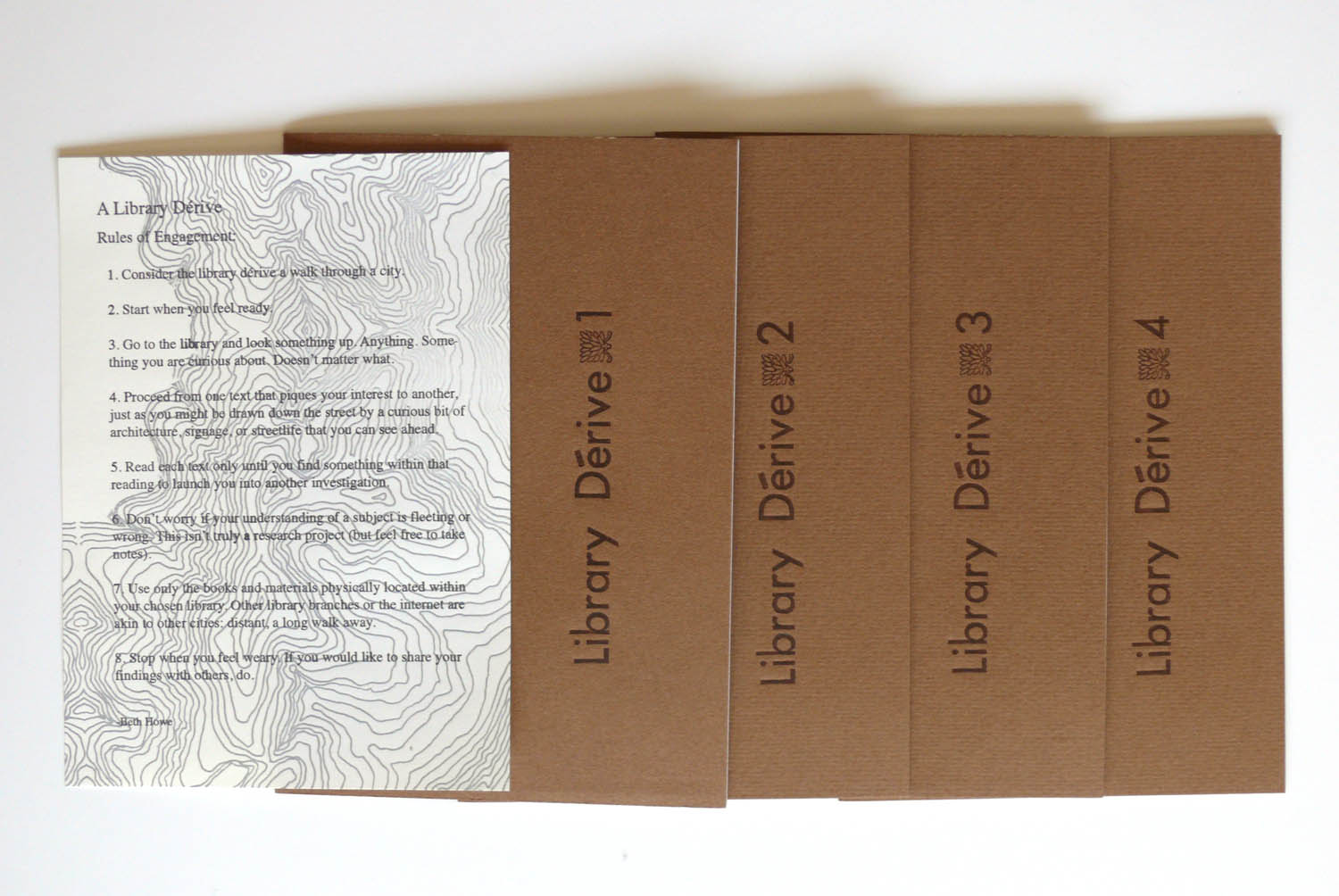 """Library Derives 1-4, 2003-2005,re-issued 2013 for  LIBRO   letterpress and laser printing, open edition sets of 4, 4.5"""" x 7"""" booklets  The practice of the 'dérive' was developed by the Situationist International as a way to travel through and experience the city. I applied their technique of non-predestinated but focused wandering to the library catalog. The resulting writing relates the information I gleaned and charts my erratic path through the texts of the library."""