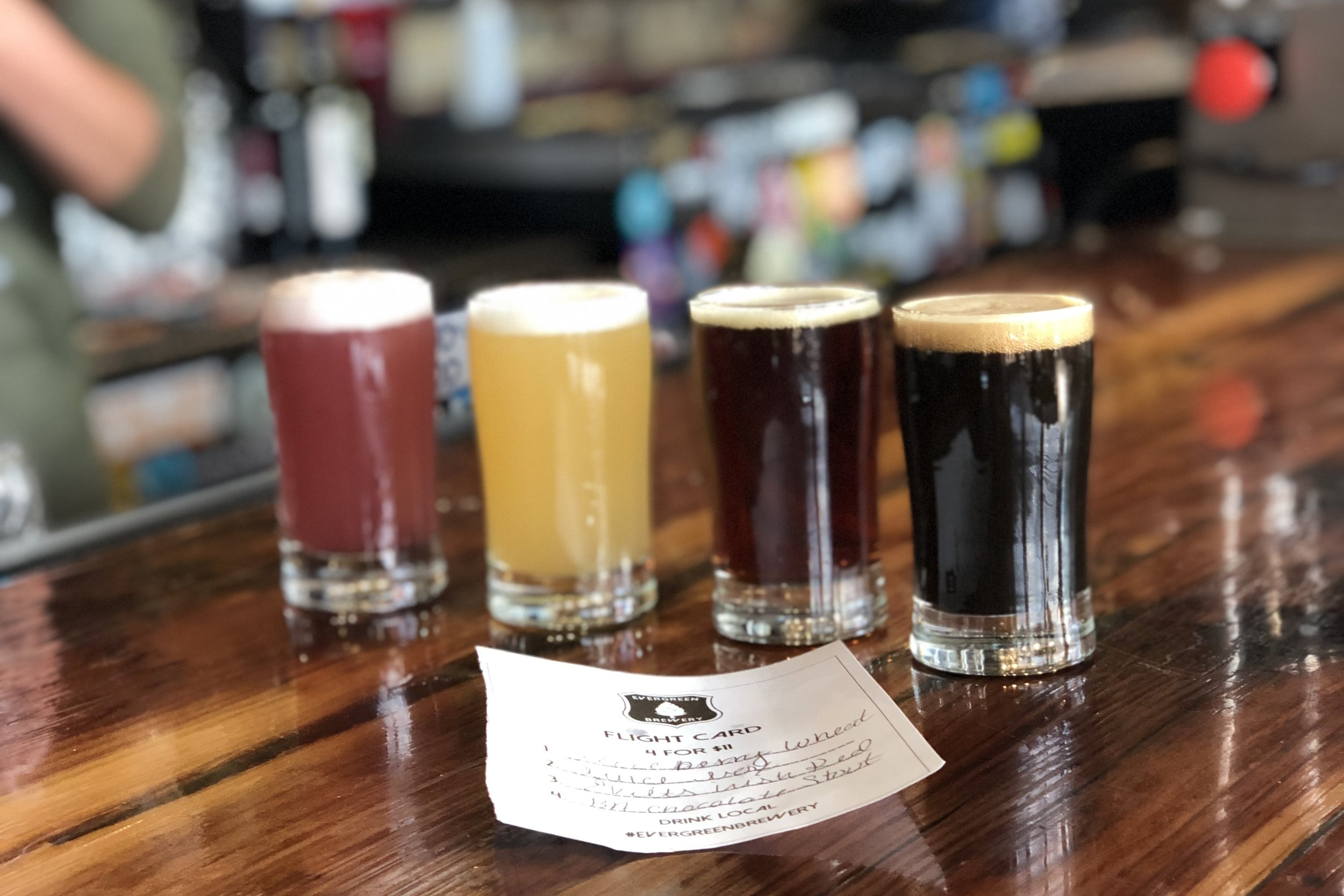 Try a flight of 4 brews for only $11 at Evergreen Brewery! ©Suzanne Brown 2019
