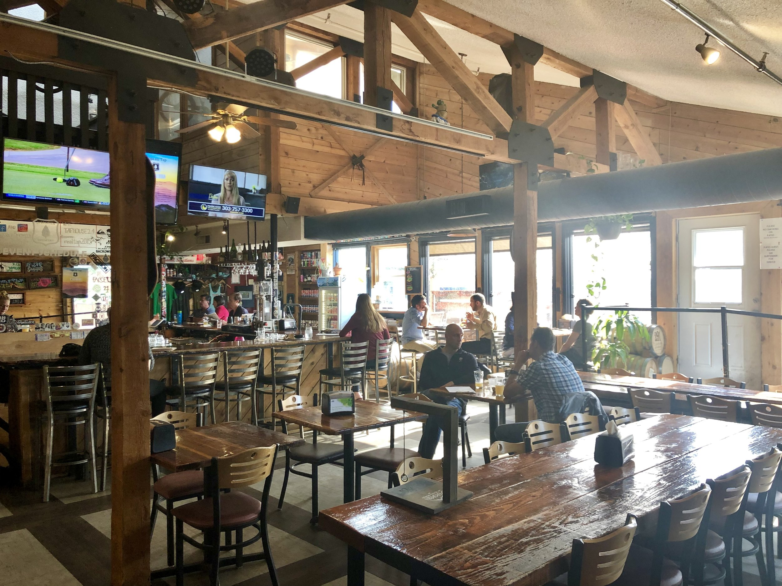 Evergreen Brewery's inside bar area boasts tall ceilings, wood accents, and a great mountain vibe. ©Suzanne Brown 2019