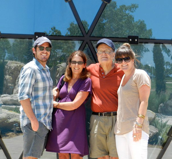 Liz, bro Patrick, her mom & dad on their first post-surgery family outing.