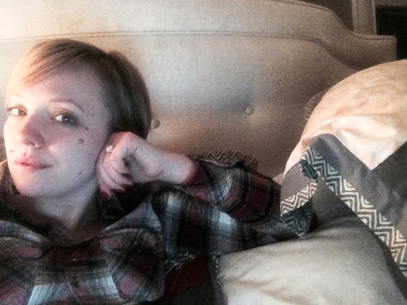 I look like I'm relaxing, but I'm really just plugging my ear so I can't hear you breathe or chew or type or live.
