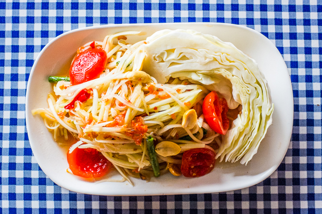 The one thing on the menu that you can't leave without ordering: the papaya salad. (Photo Credit:  Eater )
