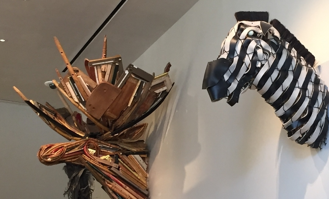 Johnston Foster (American)                  Untitled (Moosehead)  , 2012   Mixed media with broken furniture, shredded rubber tires, screws and    Zebra Trophy  , 2005   Mixed media