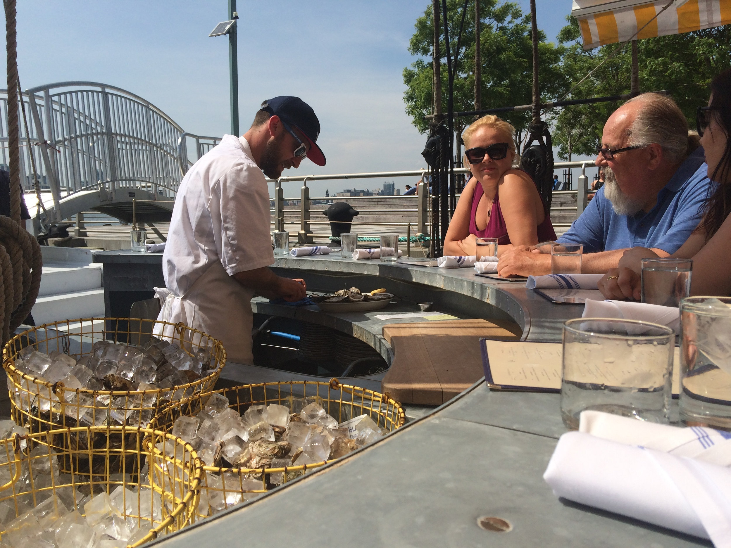 Oysters are shucked to order by a cook behind the raw bar.