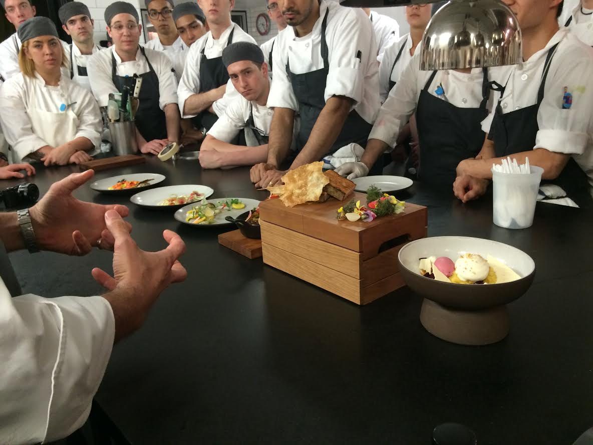 Executive Chef James Kent speaks to the cooks before five present their original dishes, having been selected to do so from all of the ideas submitted.