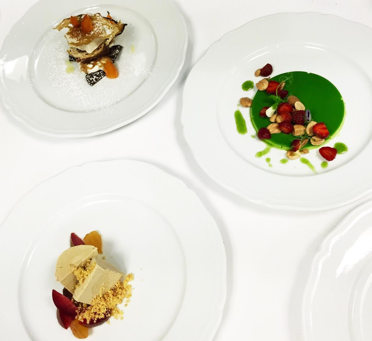 Though taken a month ago in the kitchen by Gina, this photo shows Gina's Cornetto & Cappuccino dessert, a Pea Panna Cotta (now a Corn Panna Cotta for the summer menu), and the Butterscotch Semifreddo.