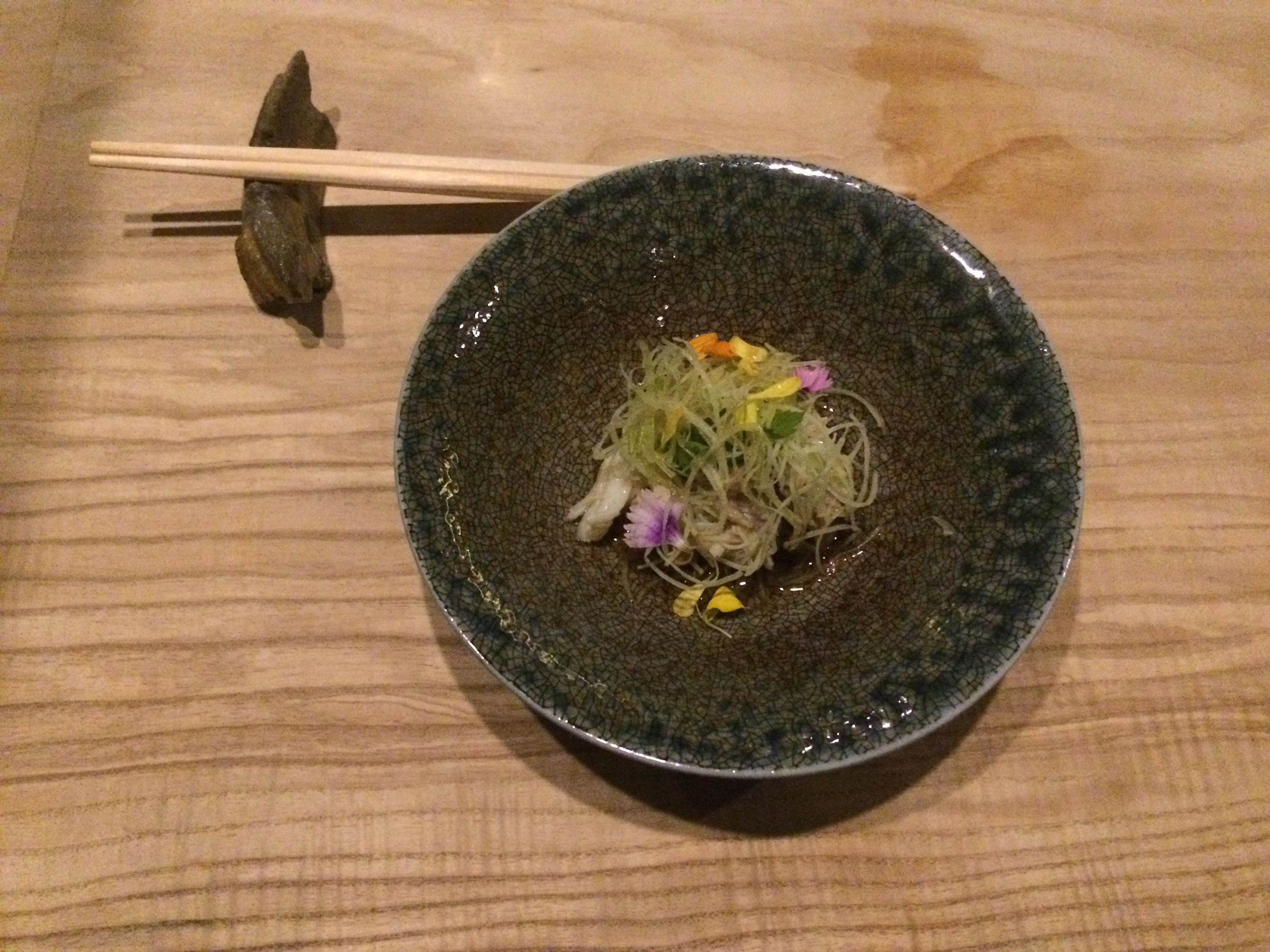 Dungeness crab and shredded cucumber serves as a bright and vinegary Sunomono salad, with chrysanthemum lending a flowery touch.