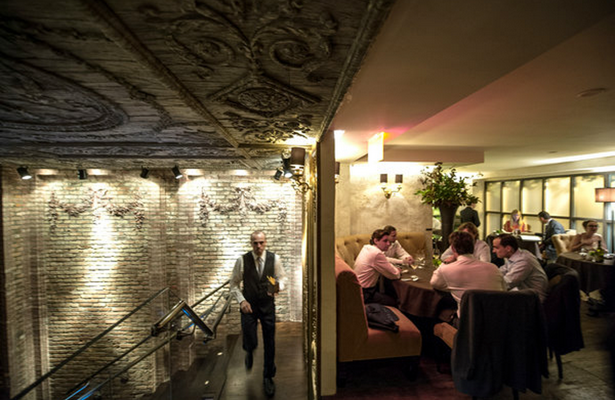 A dichotomy of modern and antiquated, Betony's upper level dining room has a similar, if more secluded atmosphere as the main level. (Photo credit: NYTIMES)