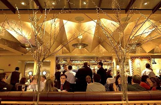 The bar area at Eleven Madison Park offers comfort, fun, and an A la Carte menu. (Photo credit:   coralambert.tumblr.com  )