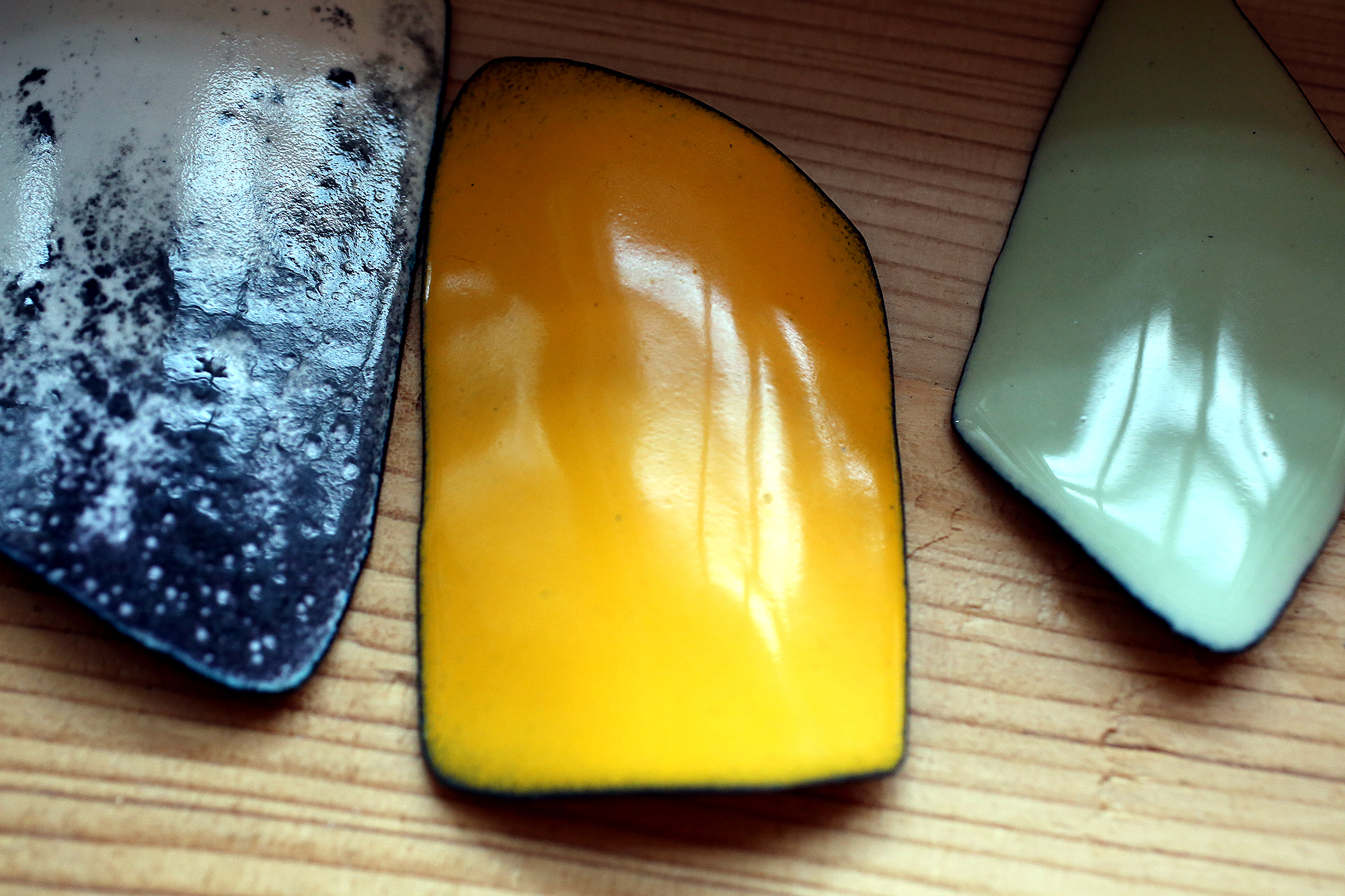 A few pieces after they have cooled- ready to become necklace pendants.