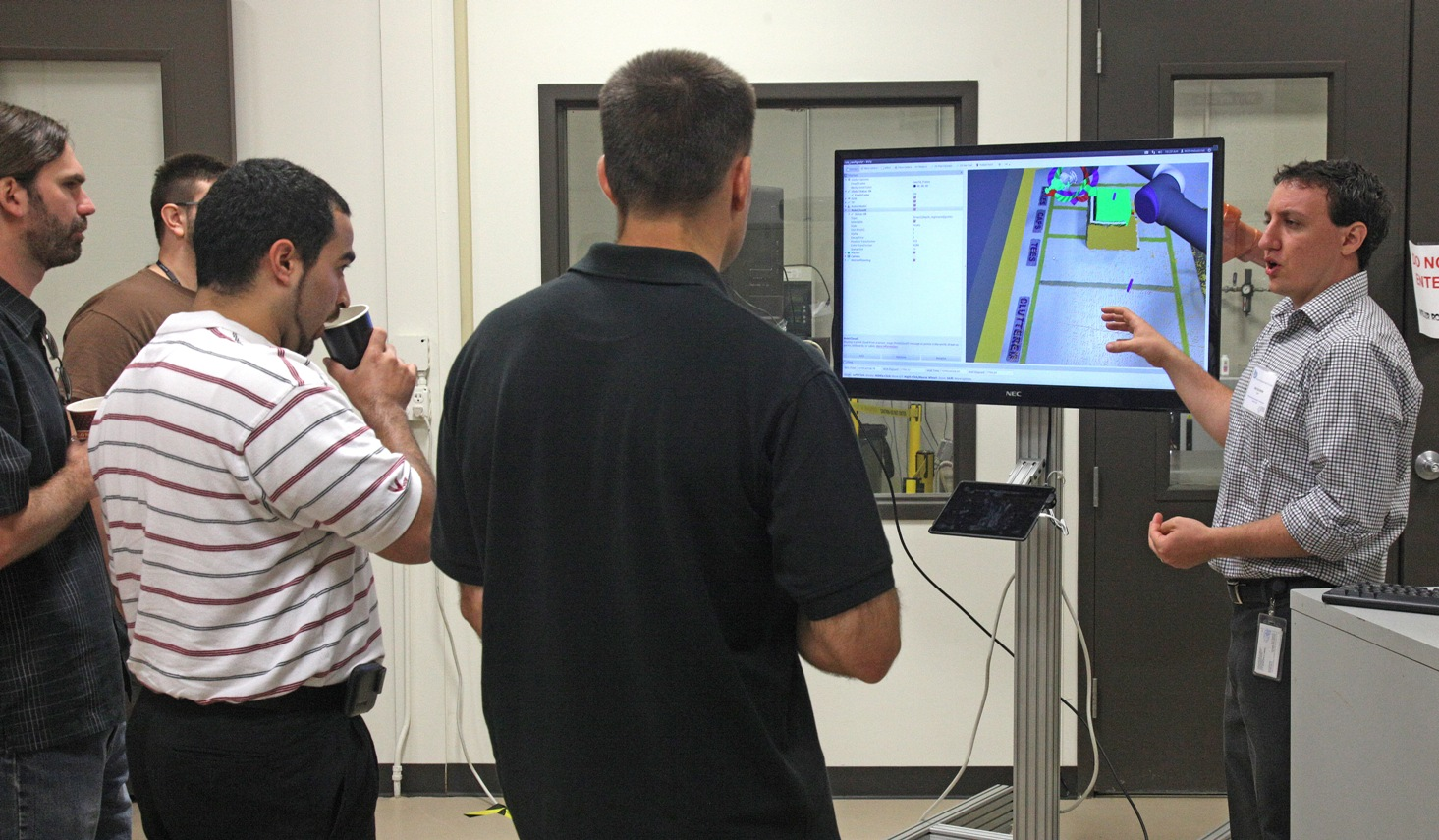 Daniel Solomon (right, SwRI) dissects the theory of operation for the capstone pick and place lab project.