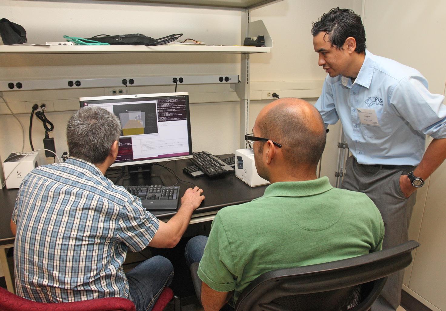 Jorge Nicho (right, SwRI) developed the tutorials for the capstone project.
