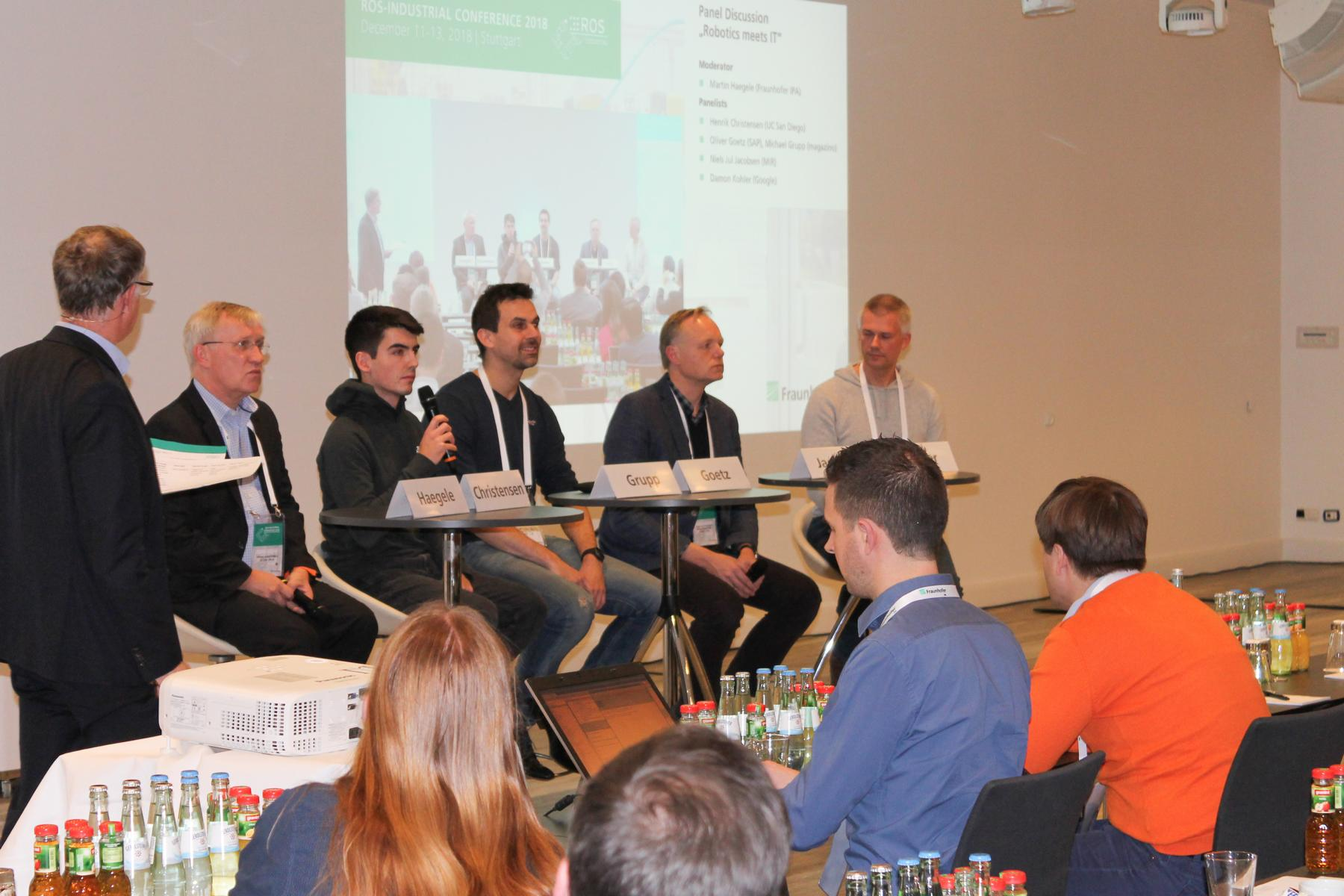Martin Hägele (Fraunhofer IPA) moderates a panel discussion with Henrik Christensen (UC San Diego), Oliver Goetz (SAP), Michael Grupp (magazino), Niels Jul Jacobsen (MiR) and Damon Kohler (Google).