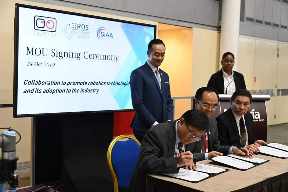 The signing ceremony taking place at ITAP 2019, Sandbox 2 on 24th October 2019.