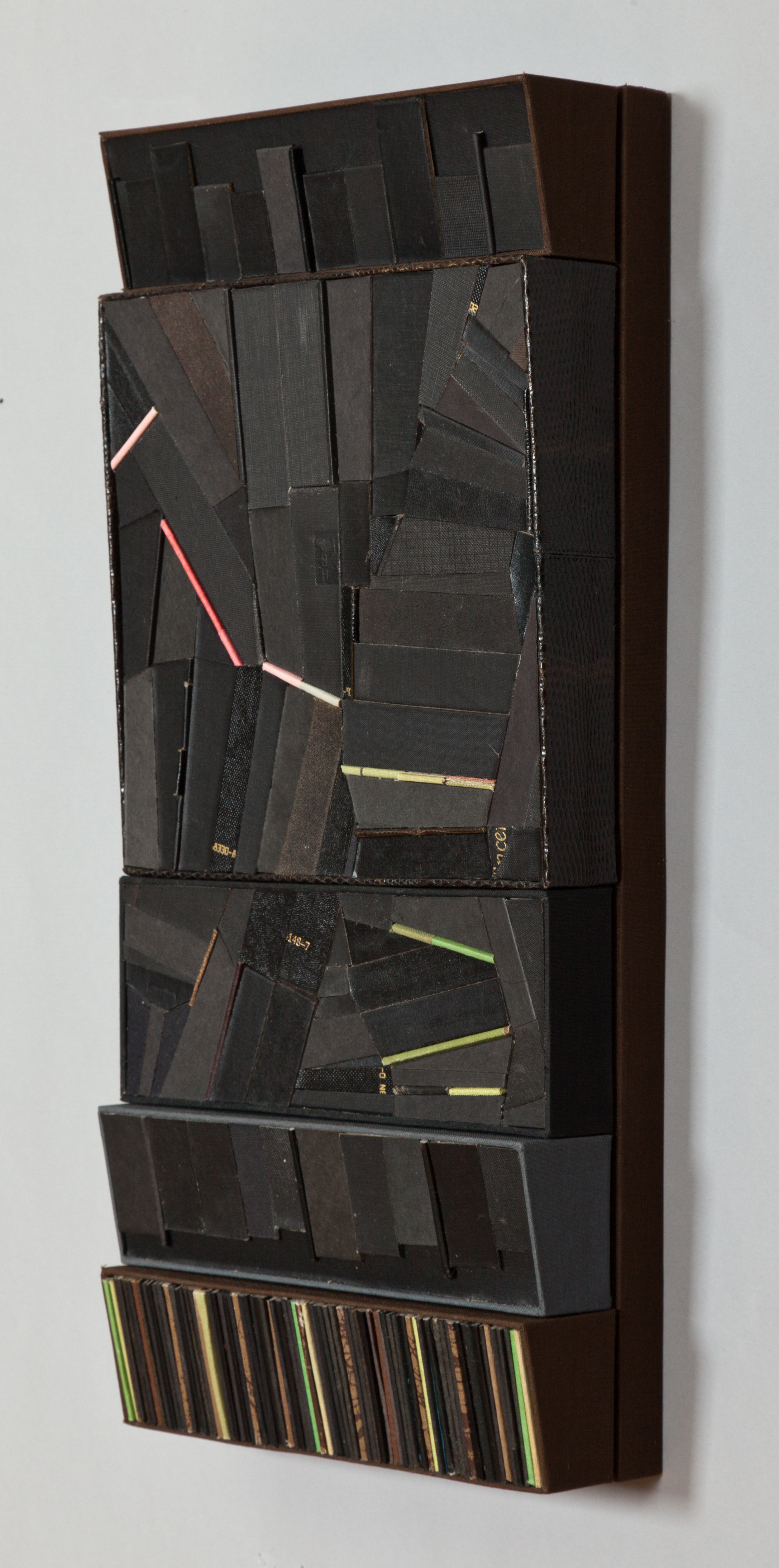 """Brooke Holve   Cover Cuts_10 , 2012  book board, cloth and used covers on birch panel   8.75"""" x 19.25"""" x 2.75""""  $1,200"""