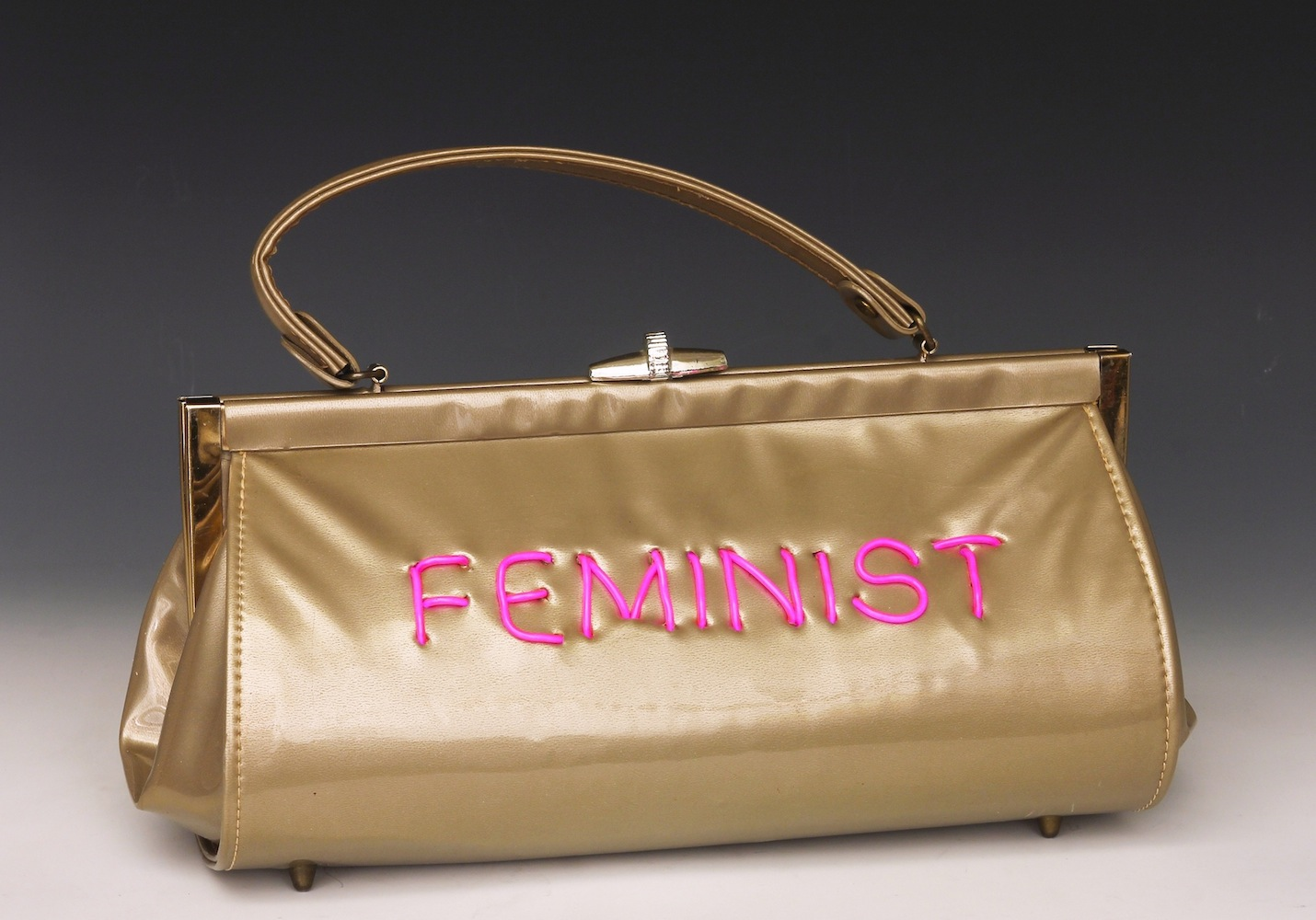 "Michele Pred   Feminist , 2015 electroluminescent wire on vintage purse 9"" x 14"" x 5"""