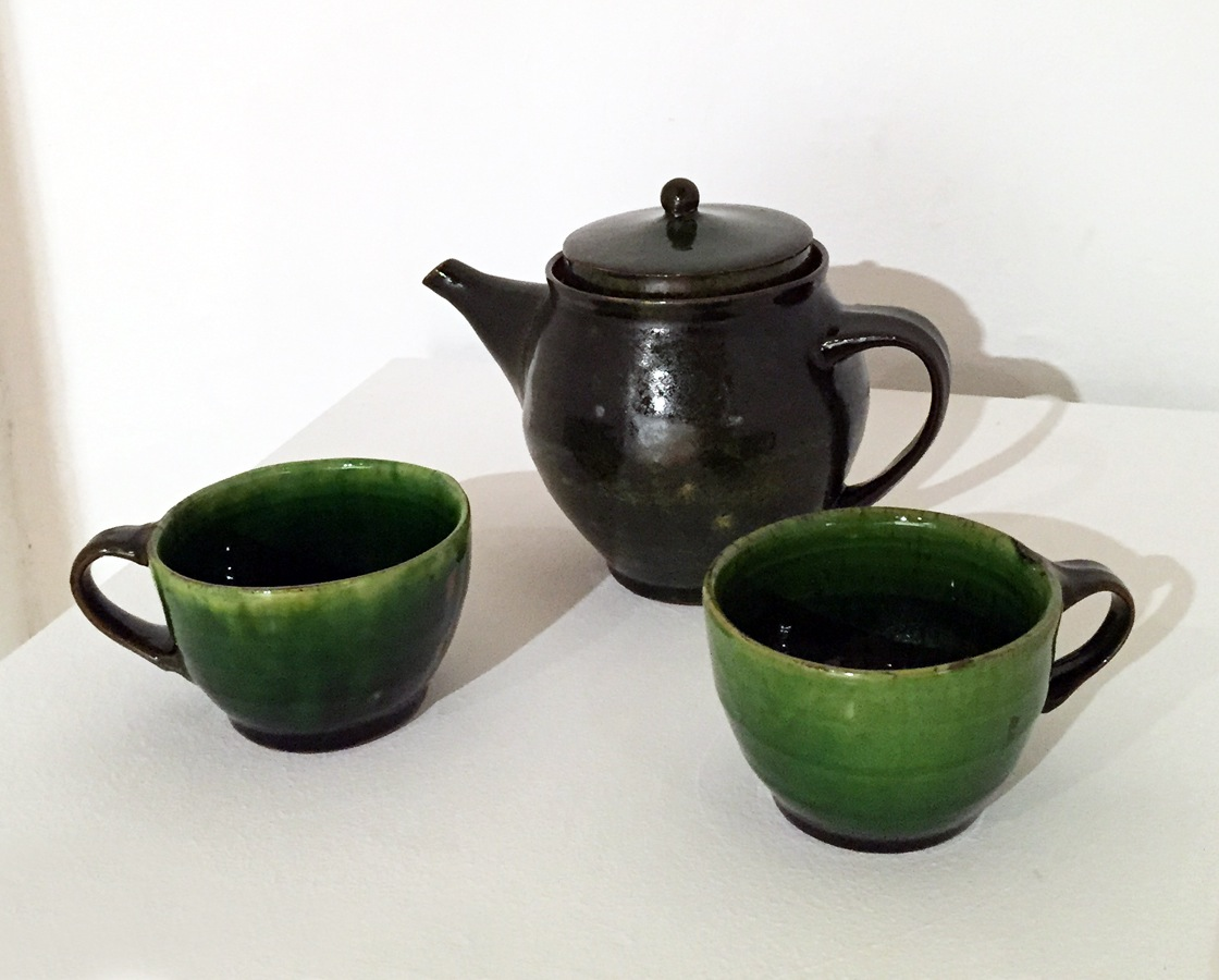"Sandy Simon   Teapot and 2 Cups , n.d. red earthenware, white slip, green glaze 8"" x 10"""