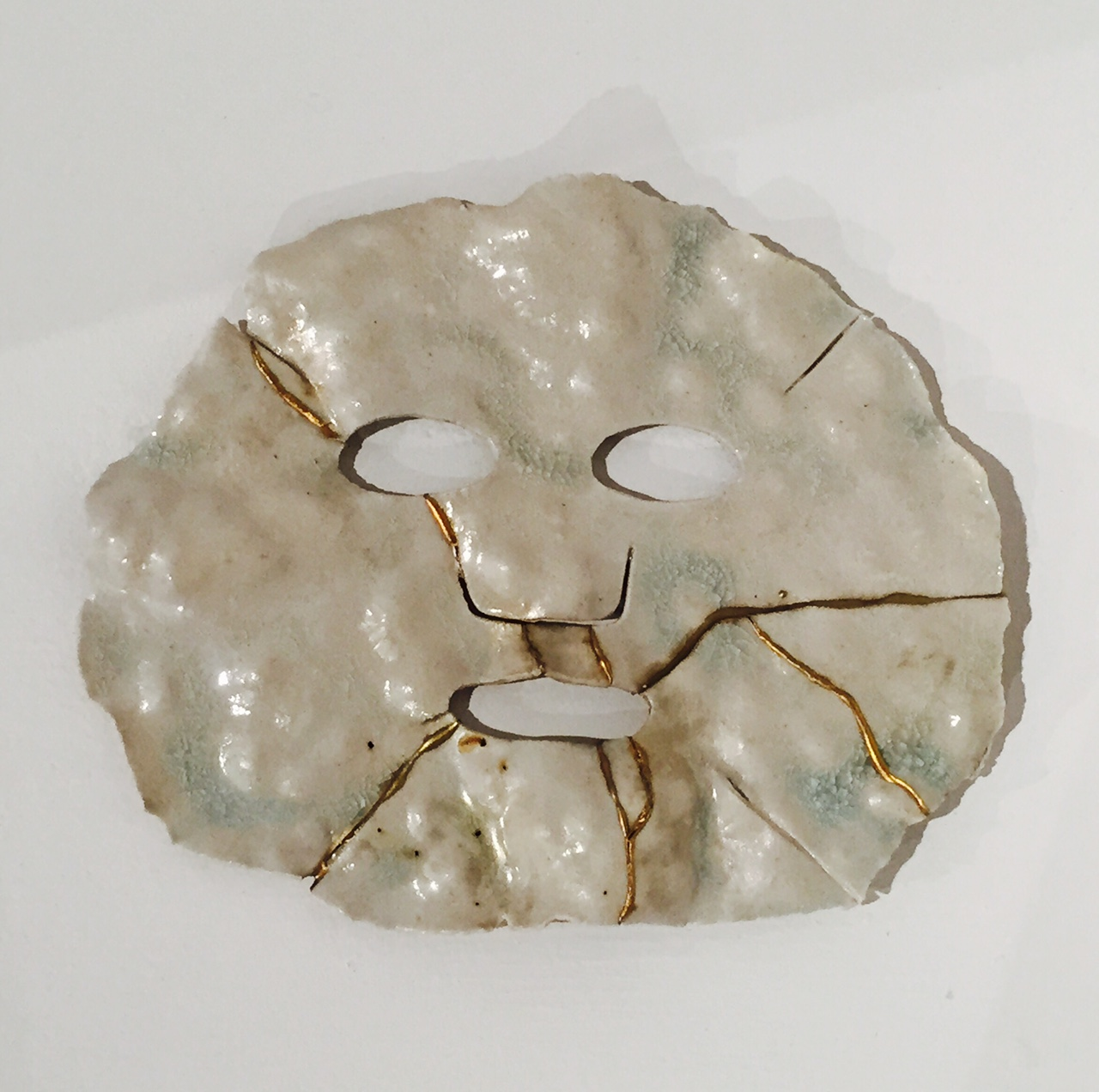 Cathy Lu  Face Sheet Mask (with Lumps) , 2017 ceramic with gold powder 6 x 9""